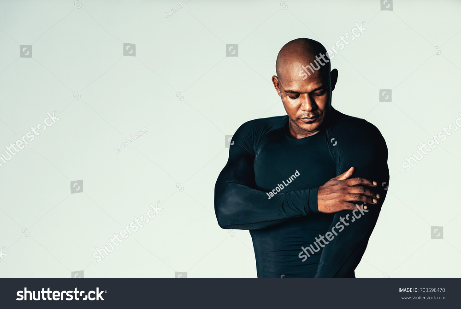 f55a9b8f9 Portrait of handsome young men in gym t-shirt over grey background. African  male