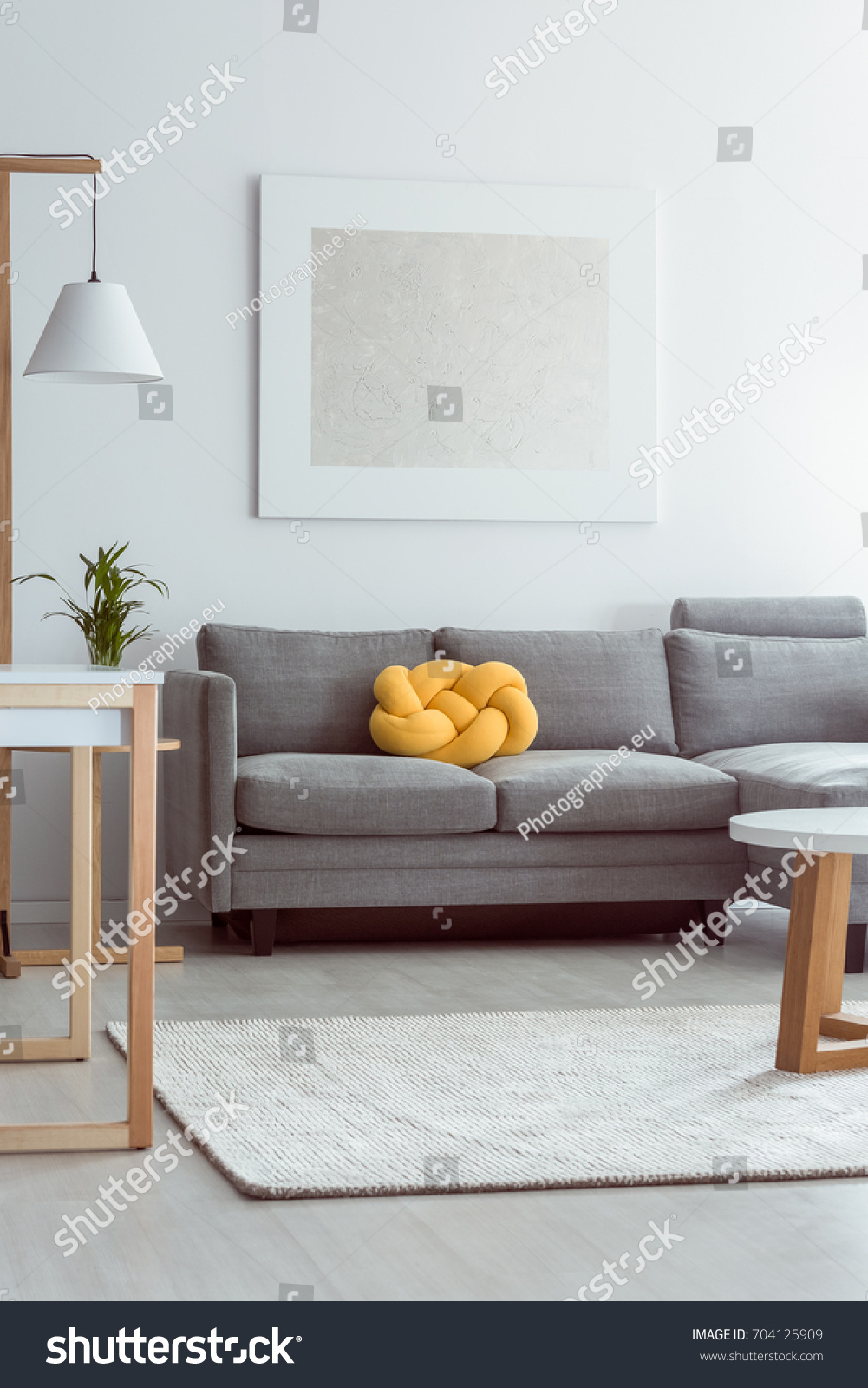 Yellow Knot Pillow On Grey Sofa Stock Photo Edit Now 704125909
