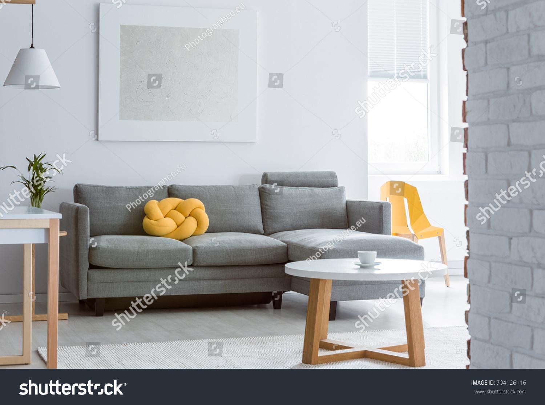 Yellow Decorative Pillow On Grey Sofa Stock Photo (Royalty Free ...