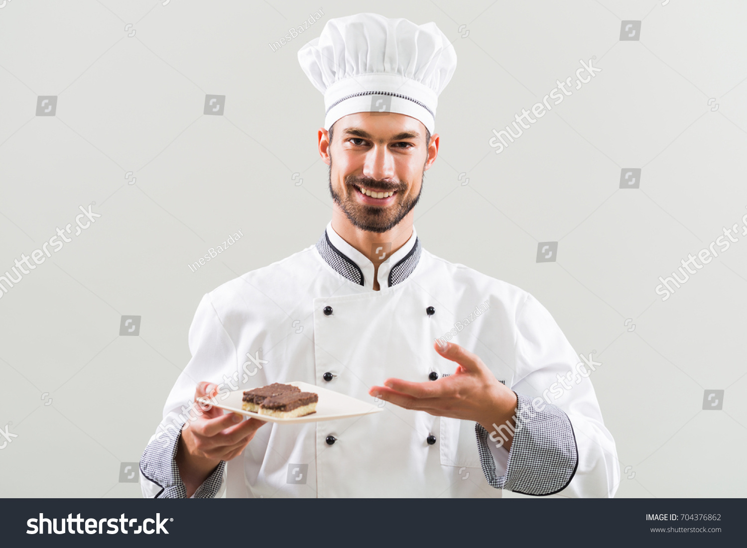 Smiling Chef Showing Slices Cake On Stock Photo (Royalty Free ...