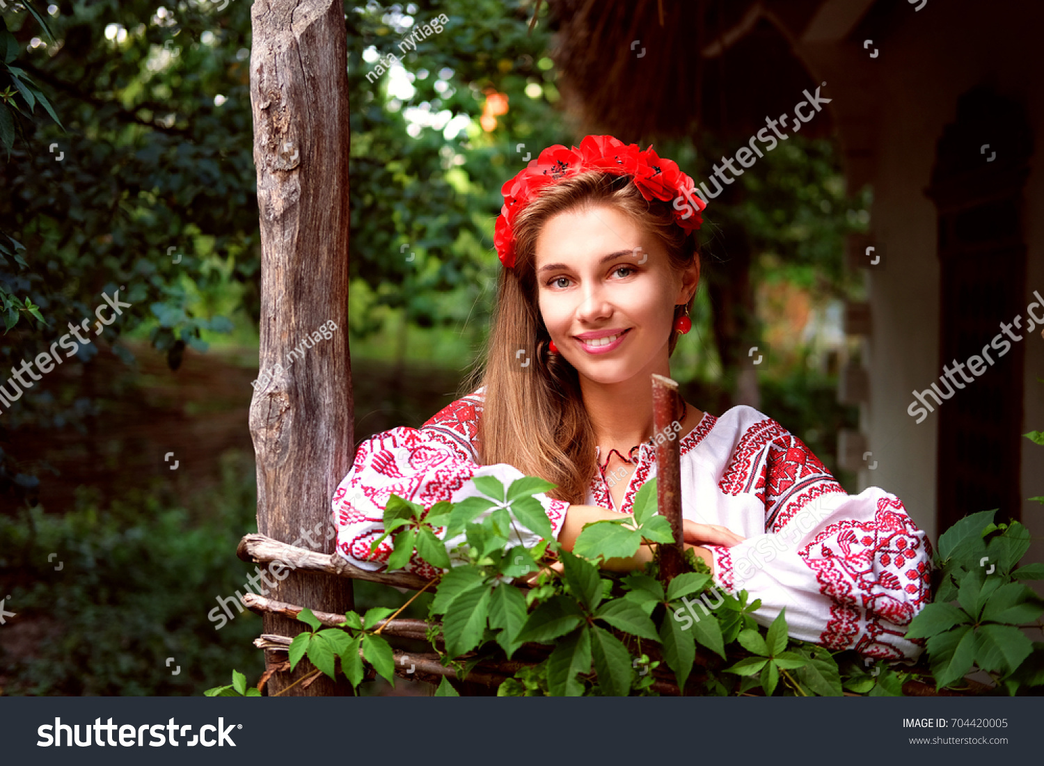 Beautiful slavonic girl long blond hair stock photo royalty free beautiful slavonic girl with long blond hair and blue eyes with flower crown in white and izmirmasajfo