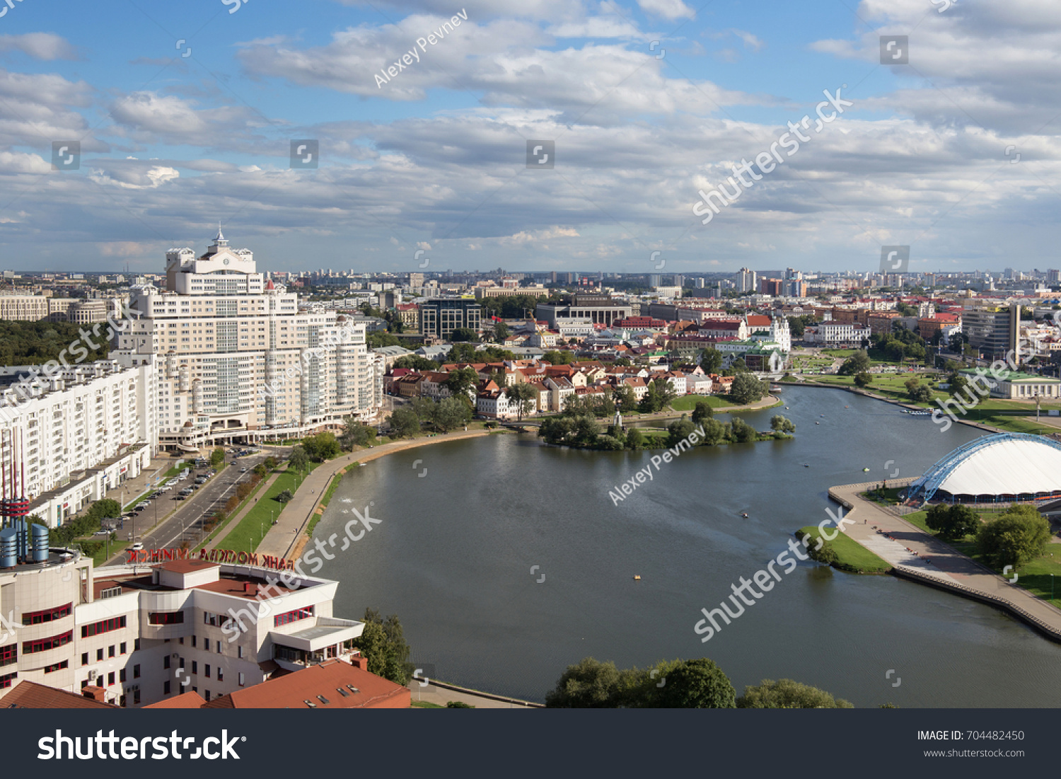 MINSK, BELARUS - AUGUST 15, 2016: Aerial view of the south part of the Minsk with Trinity Hill, Liberty Square, Sport complex and Svislach River. Minsk is the capital and largest city of Belarus.  #704482450