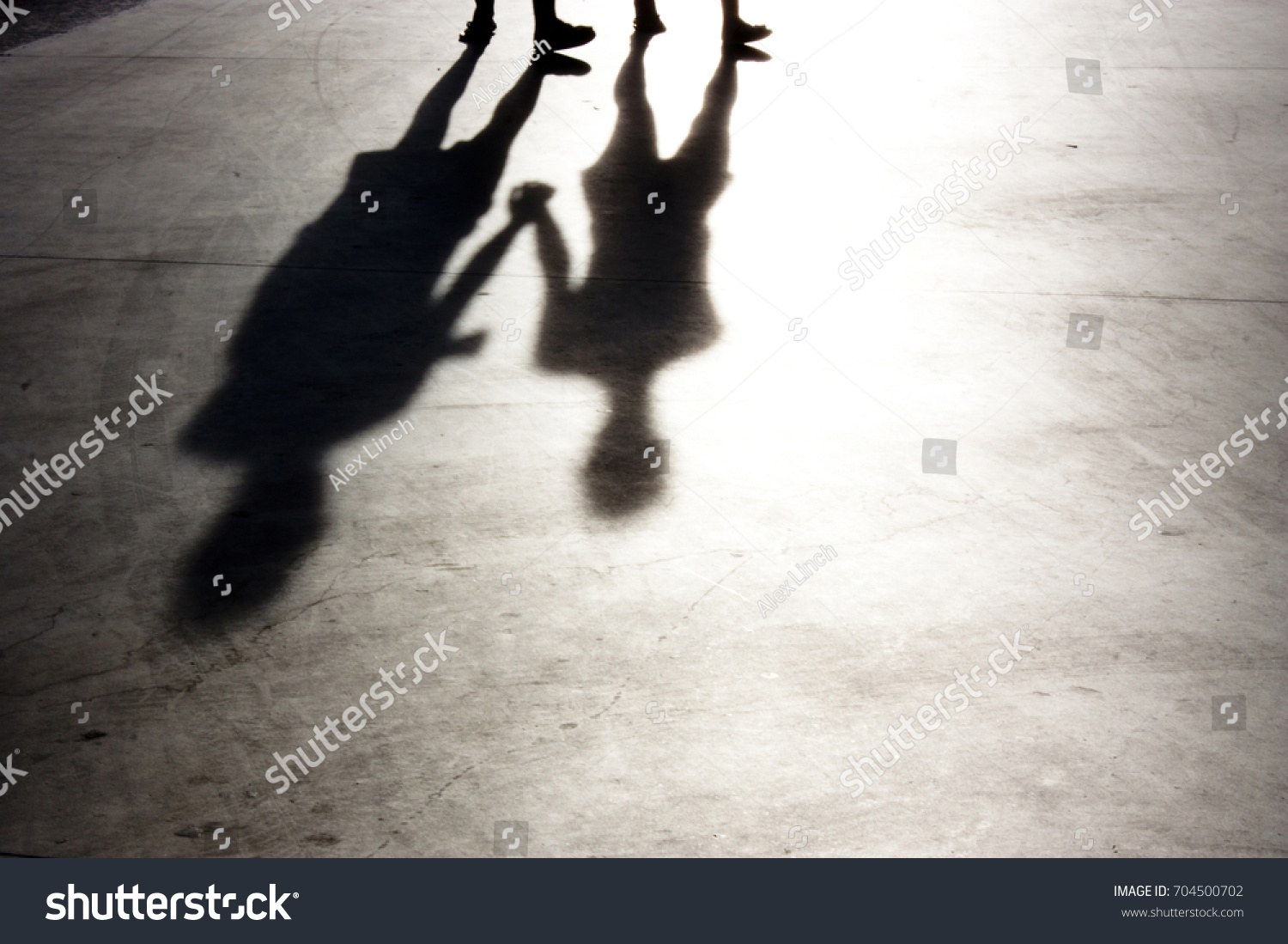 Blurry two people holding hands walking silhouette and shadow in black and  white 29eb09576a