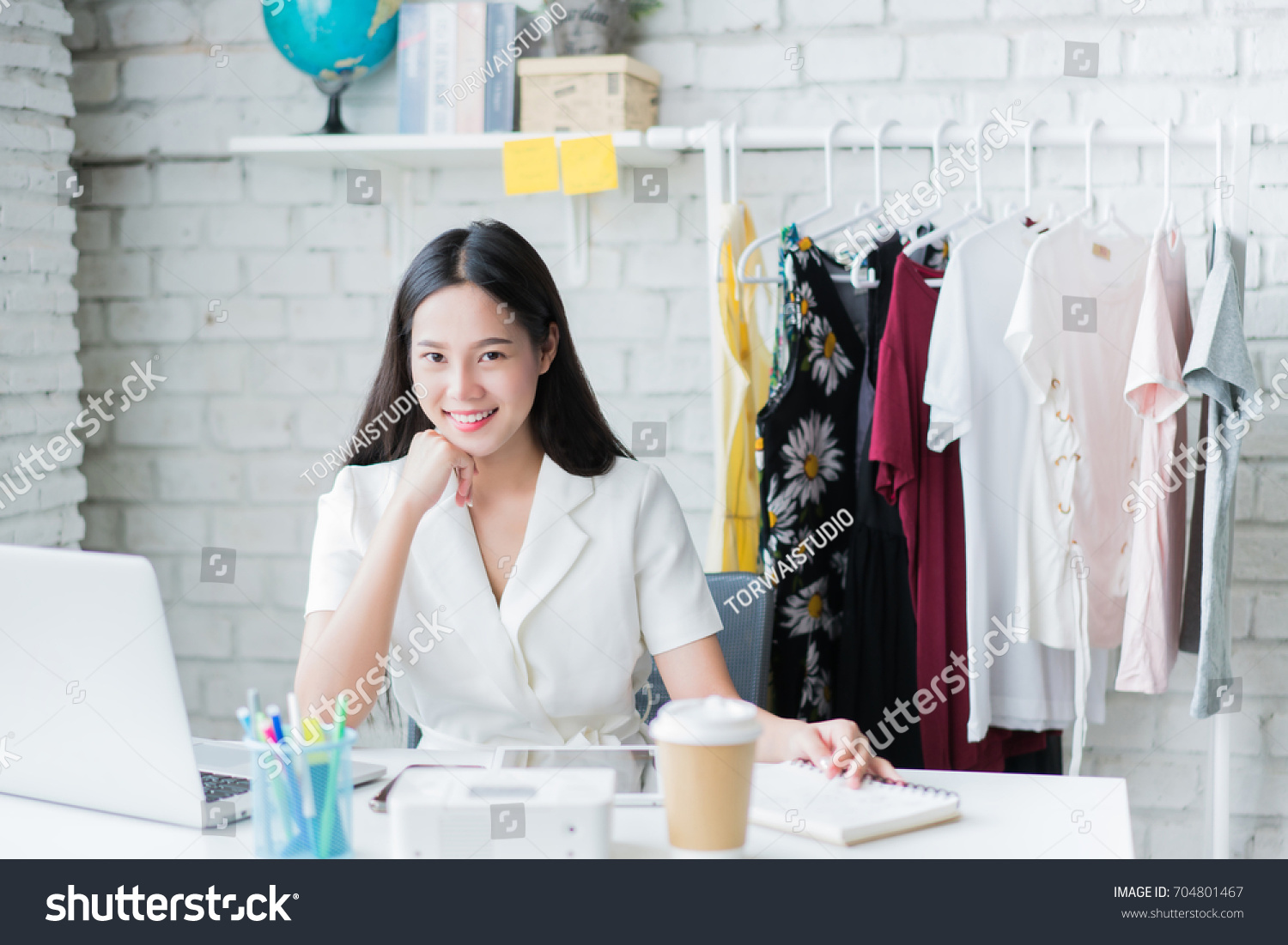 Online Women Sellers Selling Clothes Via Stock Photo