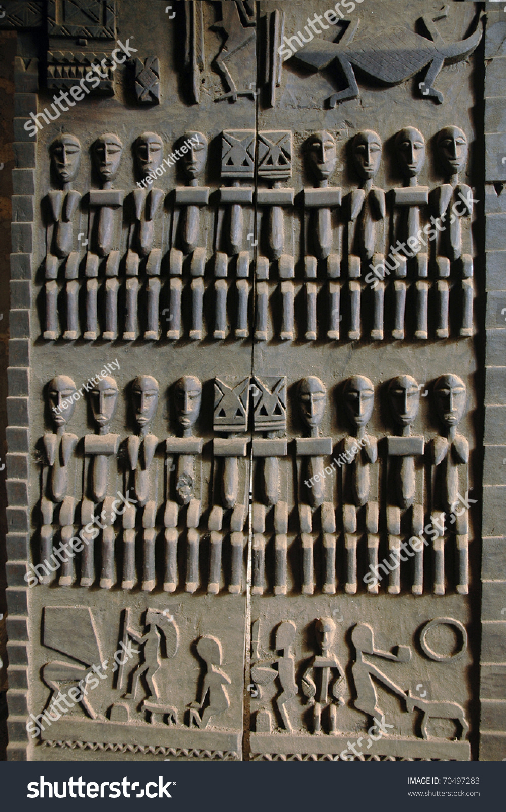 A close up of a traditional hand carved Dogon door & Close Traditional Hand Carved Dogon Door Stock Photo (100% Legal ...