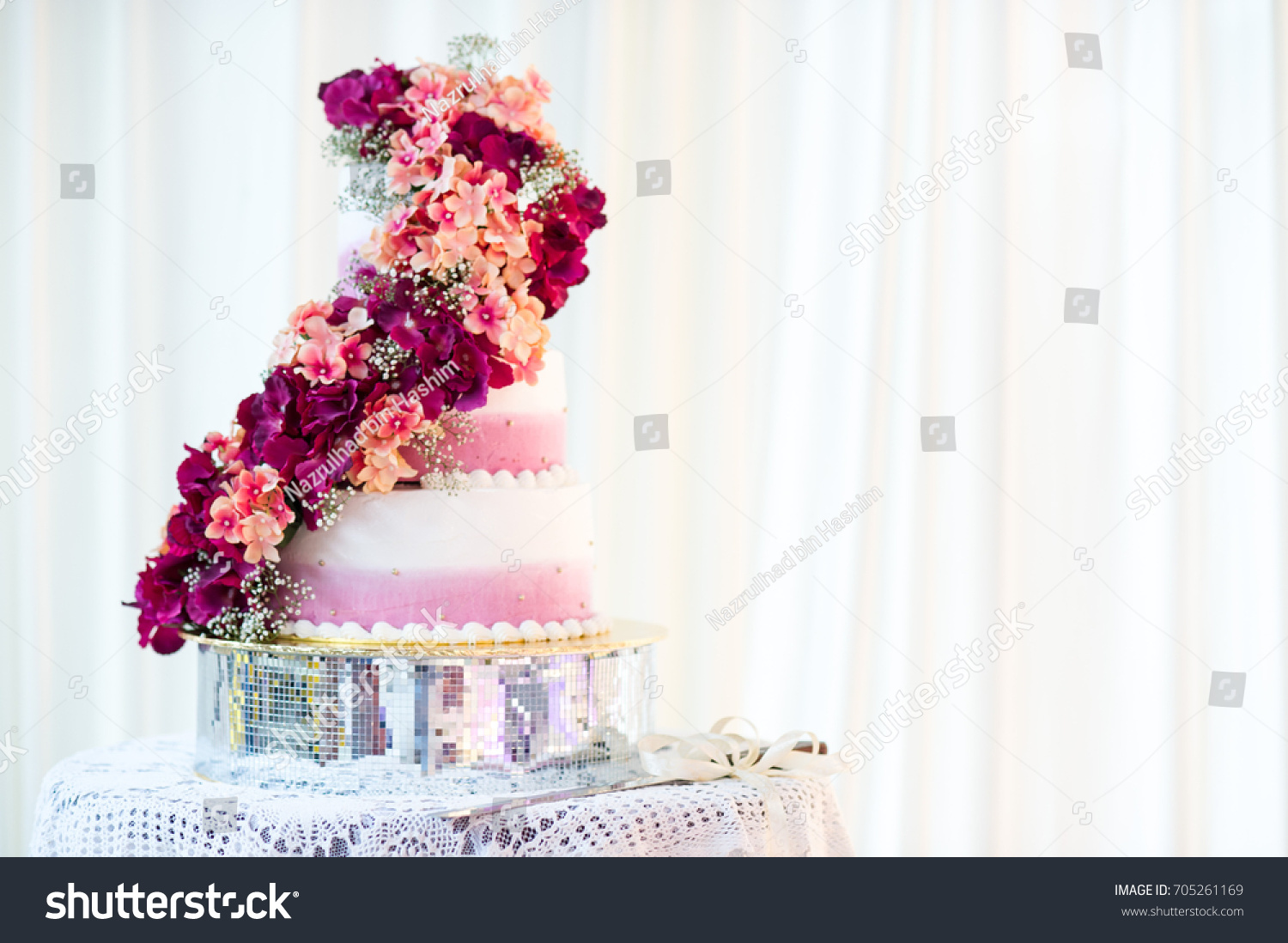 White Wedding Cake Red Flowers Stock Photo (Royalty Free) 705261169 ...