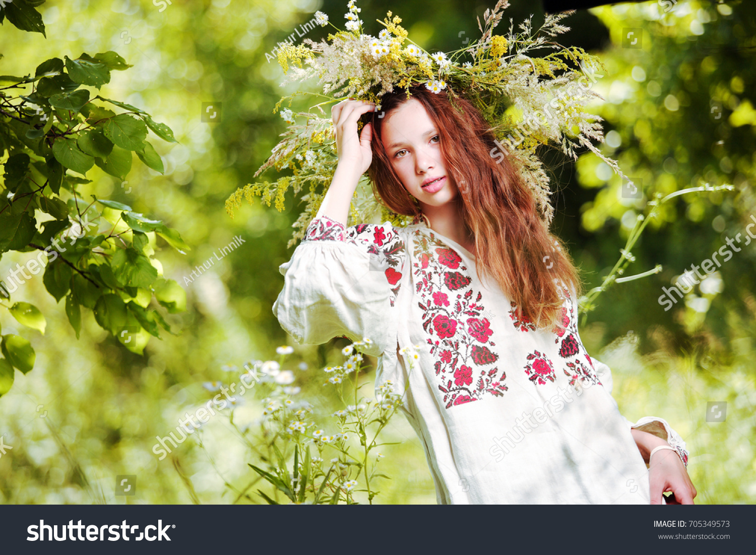 Beautiful lady forest collects flowers wreath stock photo royalty a beautiful lady in the forest collects flowers for a wreath in a traditional dress izmirmasajfo Image collections