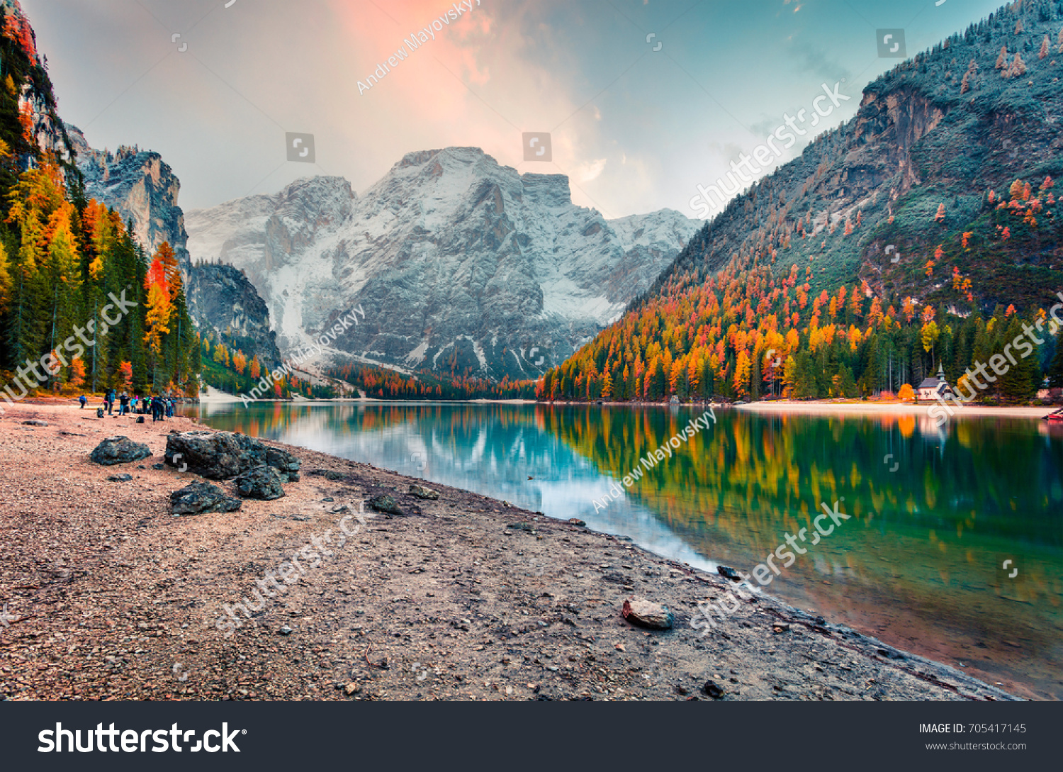 Popular photographers attraction of Braies Lake. Colorful autumn landscape in Italian Alps, Naturpark Fanes-Sennes-Prags, Dolomite, Italy, Europe. Beauty of nature concept background. #705417145