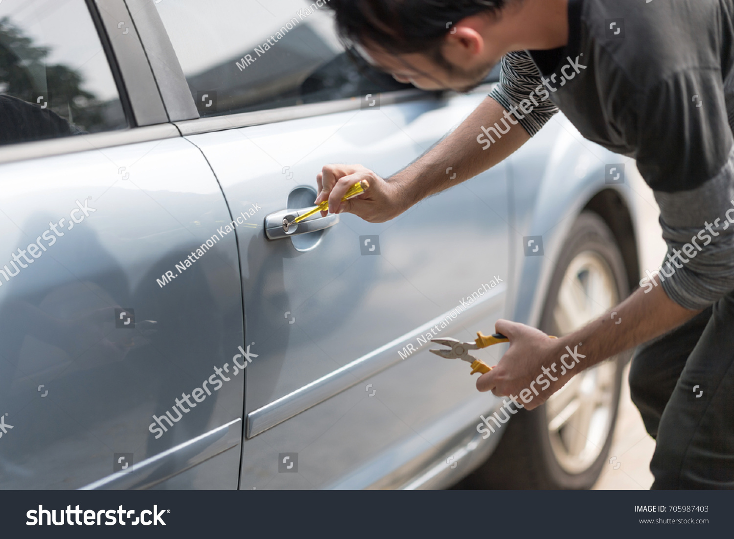 Asian Man Holding Screwdriver Trying Break Stock Photo 705987403 ...