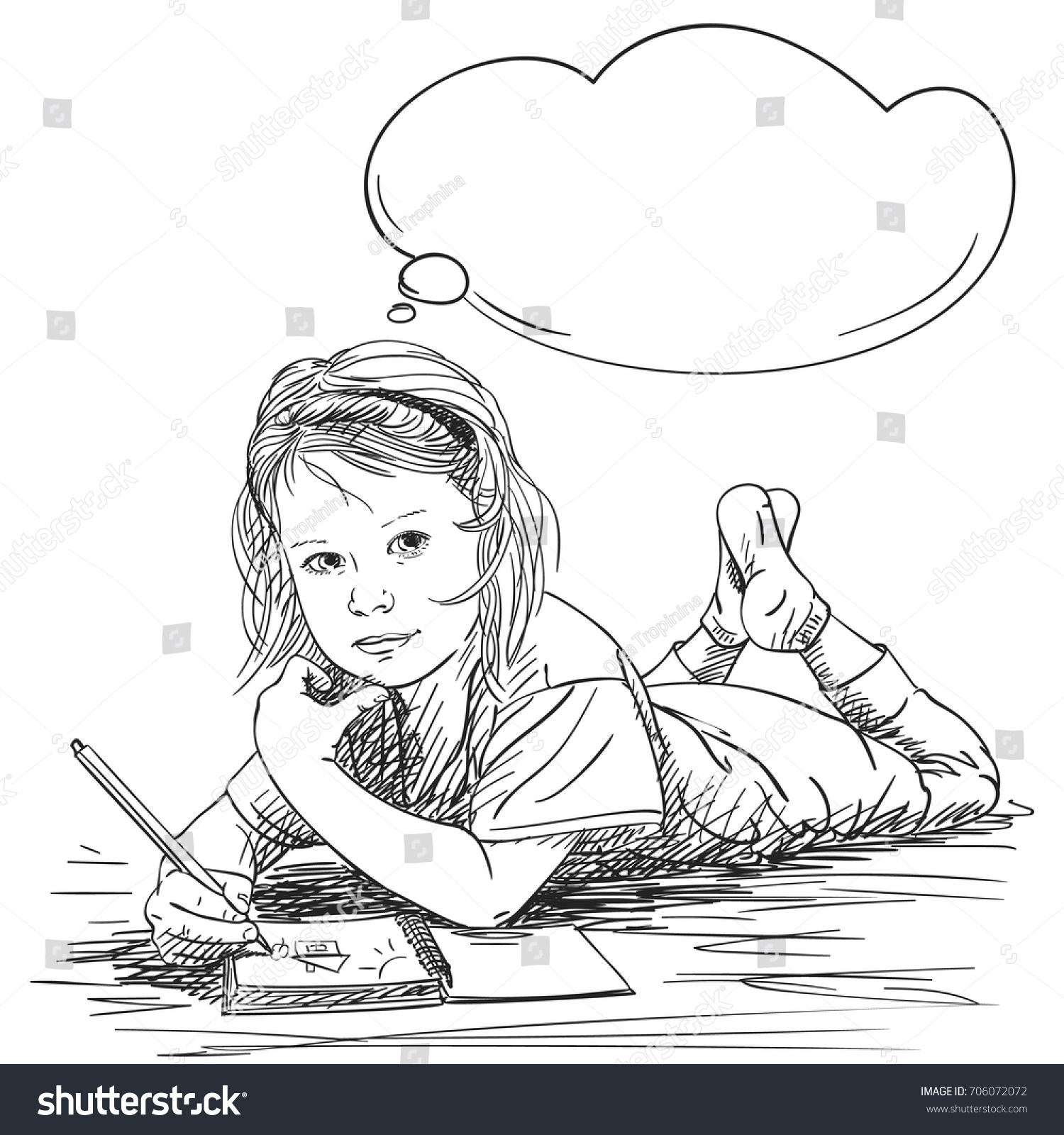 child girl drawing house and sun in note book while lying on floor and dreaming