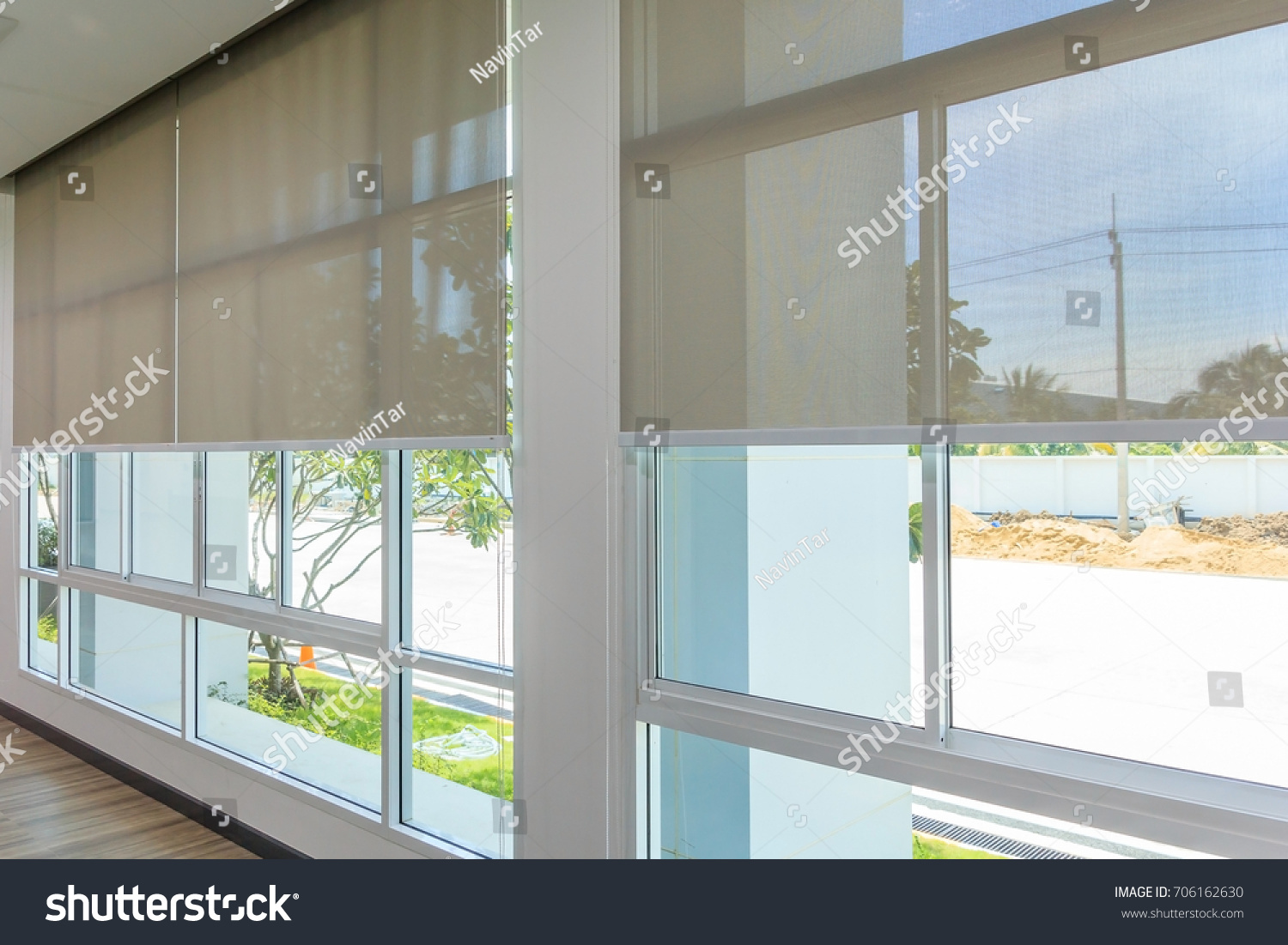 Roll Blinds on the windows, the sun does not penetrate the house. Window in the Interior Roller Blinds. Beautiful Blinds on the Window, the Sun and Heat Protection, the Perfect Windows Interior Decor #706162630