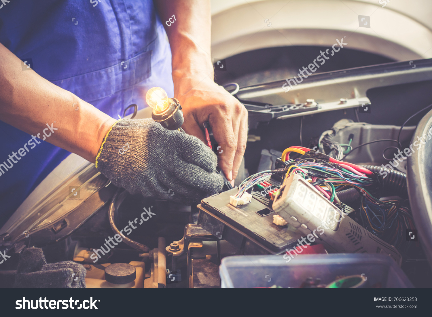 Technicain Checking Car Fuse By Lamp Stock Photo Edit Now Automobile Box Tester Which Nagative Pole Of Connected With
