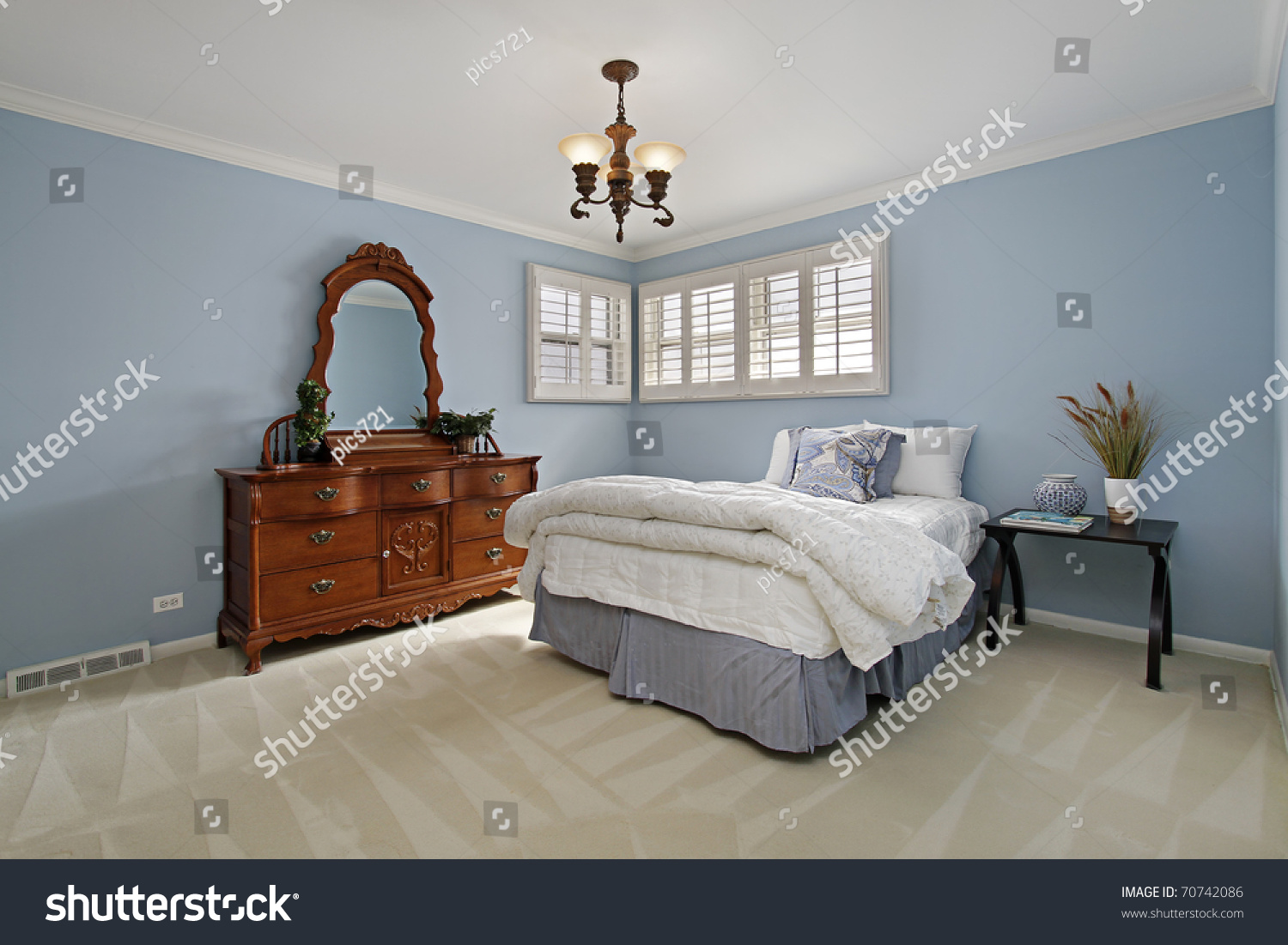 Master bedroom in suburban home with light blue walls stock photo 70742086 shutterstock Master bedroom light blue walls