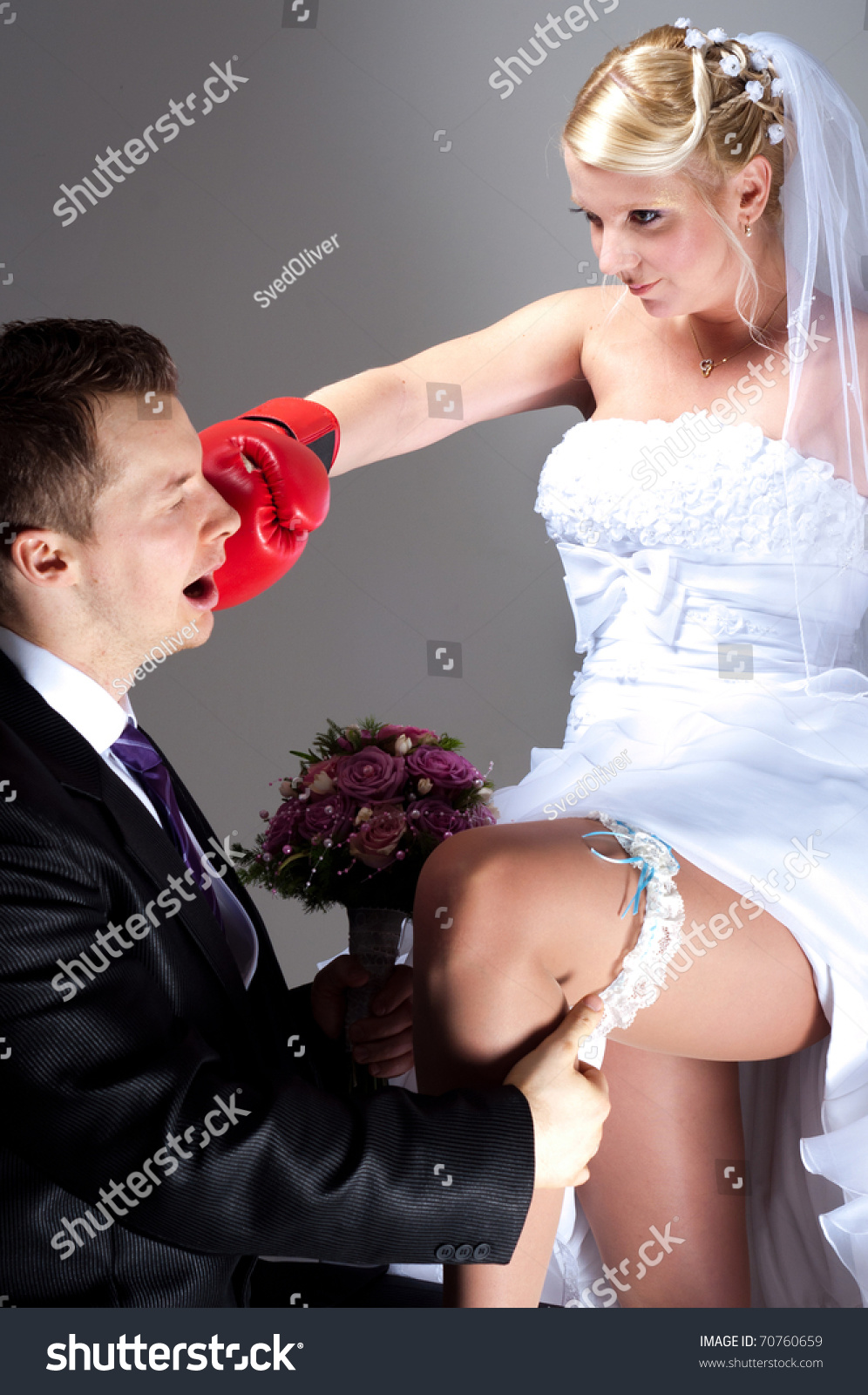 Young Bride Hitting Groom While He Takes Off Wedding Garter Stock Photo 70760659 Shutterstock