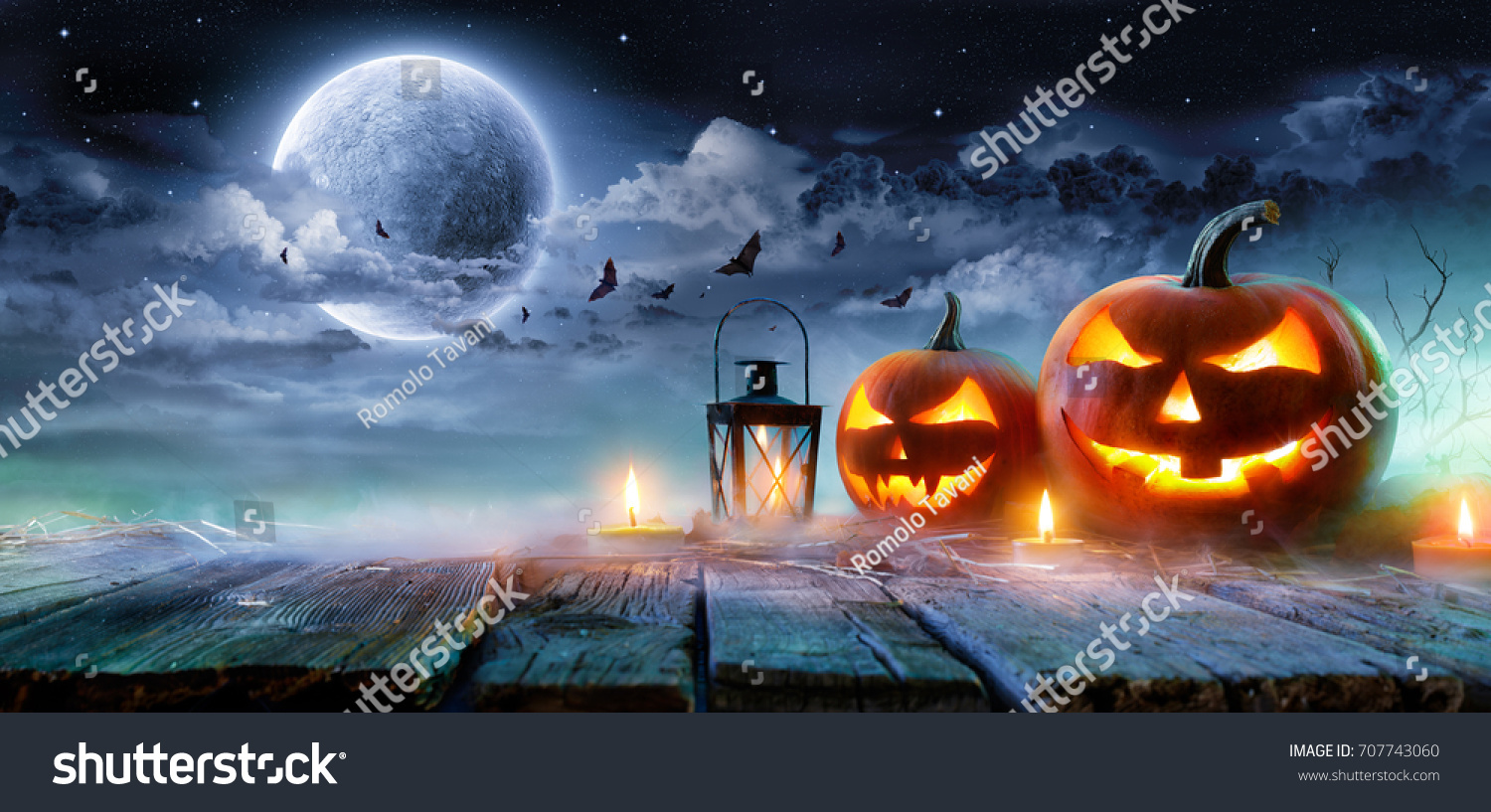 Jack O' Lanterns Glowing At Moonlight In The Spooky Night - Halloween Scene  #707743060