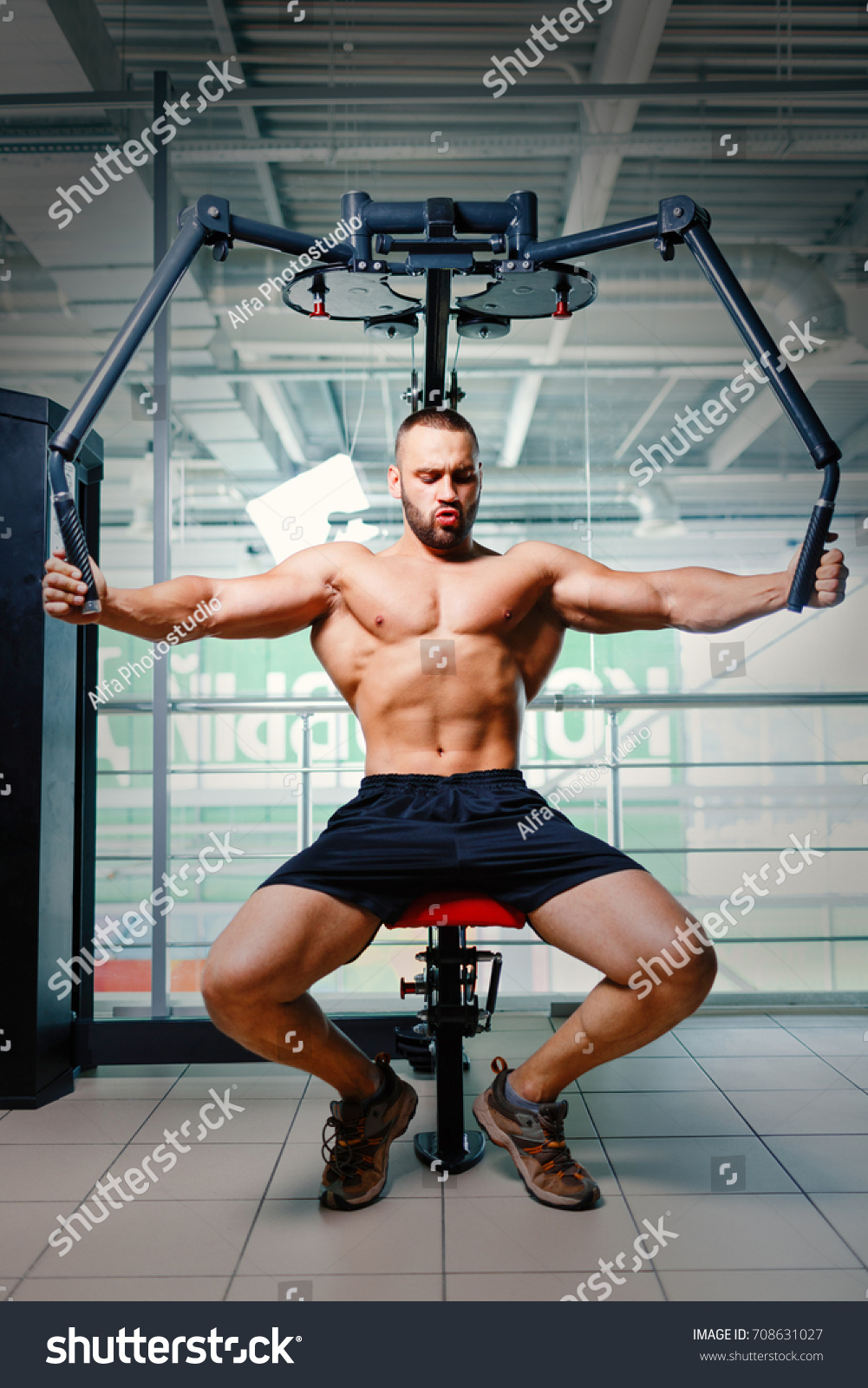 Brutal Athletic Bodybuilder Pumping Muscles On Stock Photo Royalty