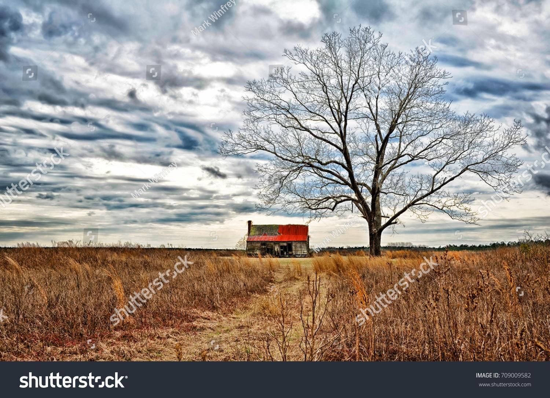 stock-photo-an-abandoned-farmhouse-and-o