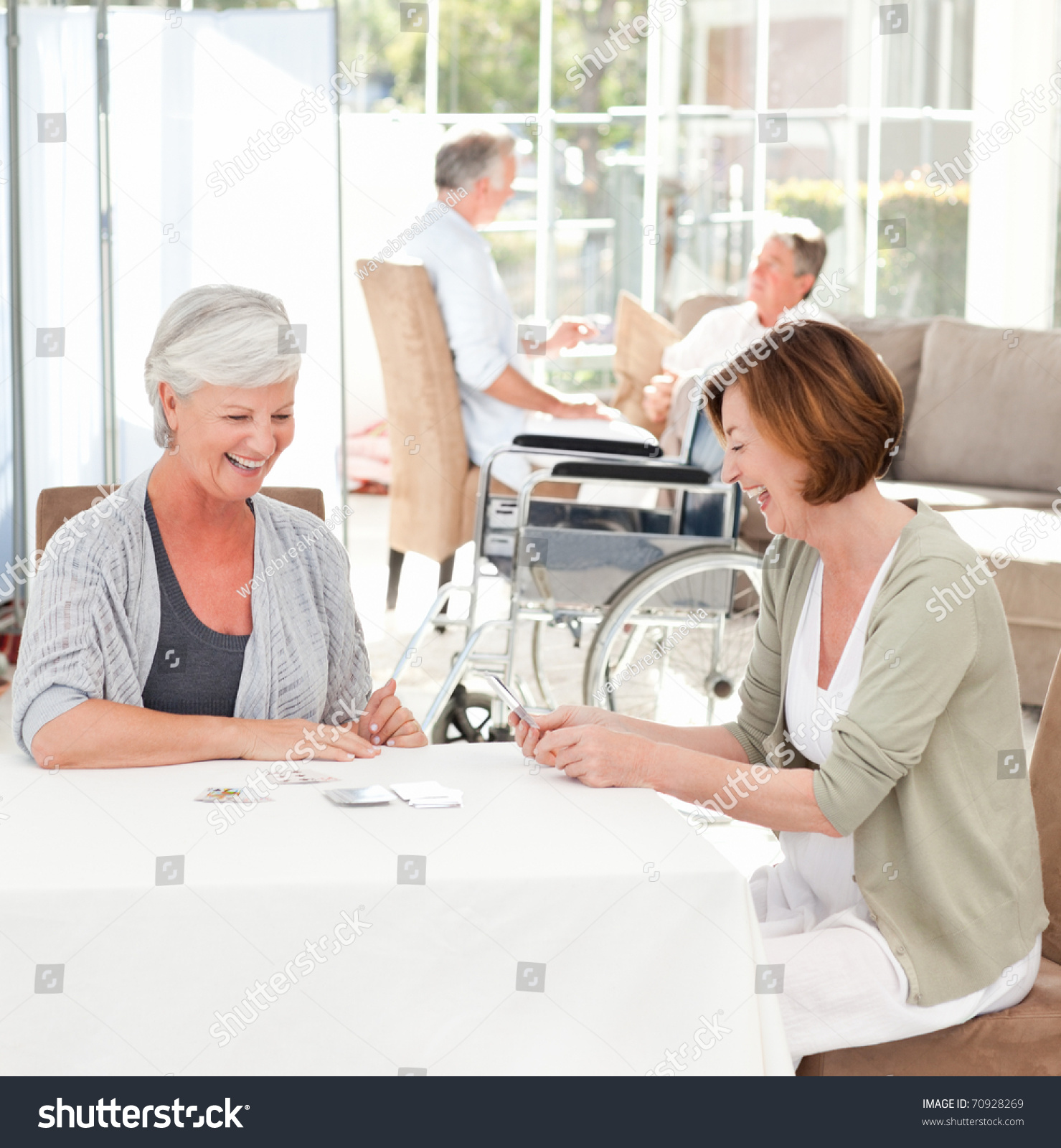 Senior Women Playing Cards While Their Stock Photo 70928269 - Shutterstock-7764