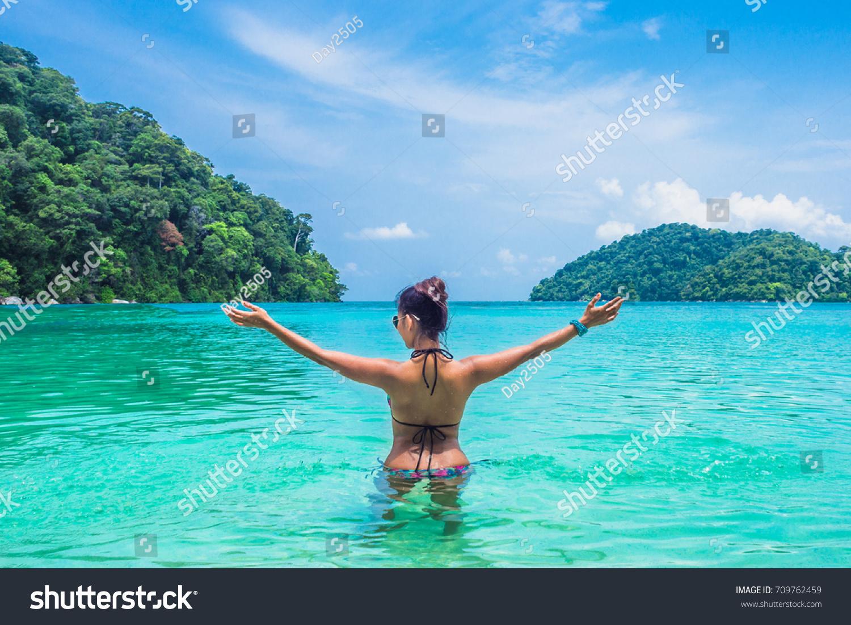 backside woman bikini relaxing on sea stock photo & image (royalty