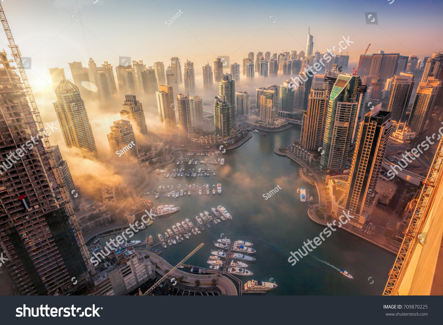 Dubai Marina with colorful sunset in Dubai, United Arab Emirates #709870225
