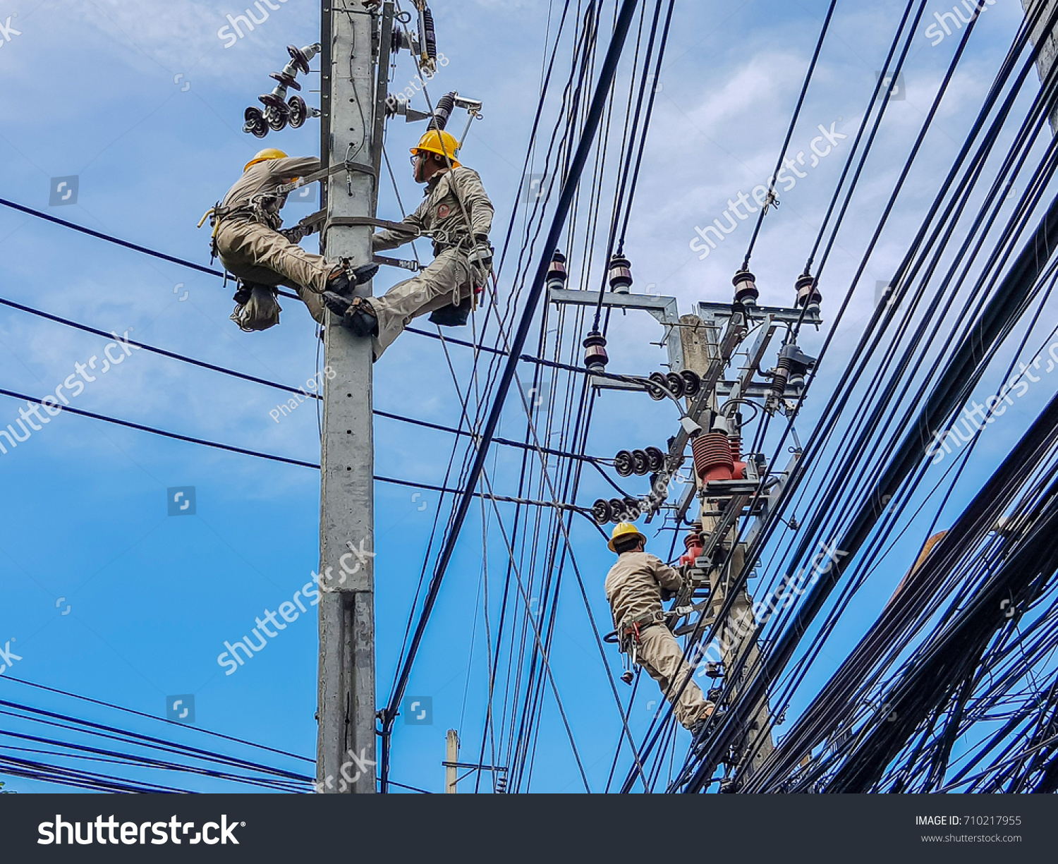 Electrical power-line installers and repairers Electrical power-line installers and repairers new photo