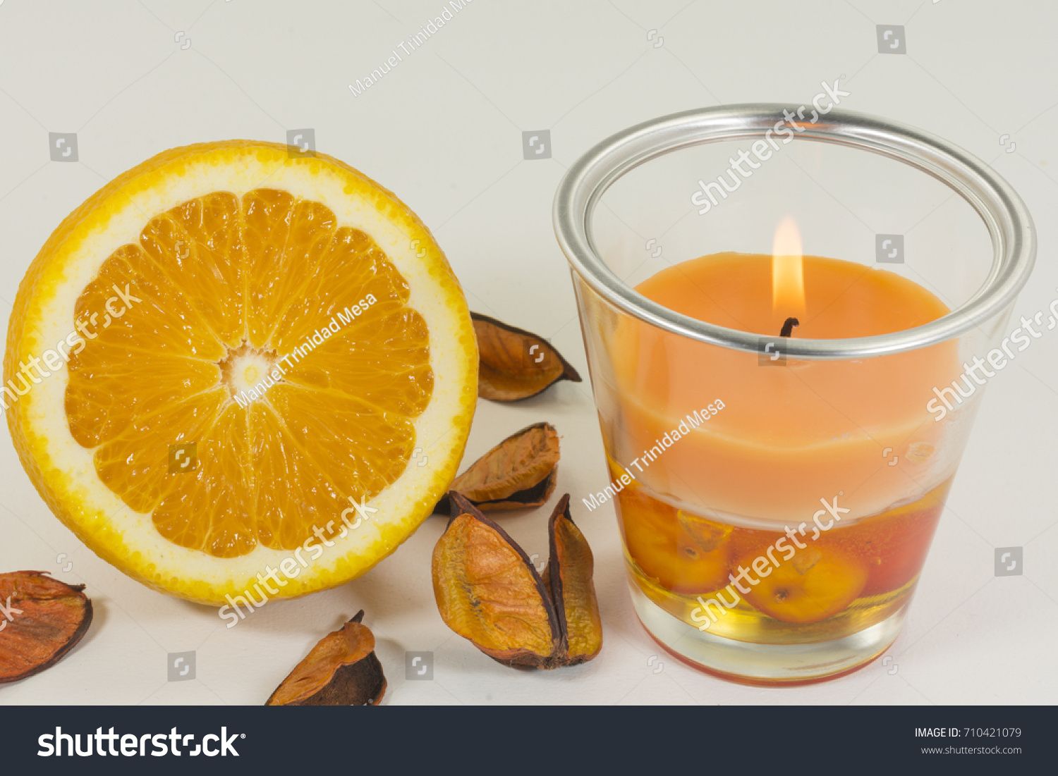 Aromatic candle for home with orange odor