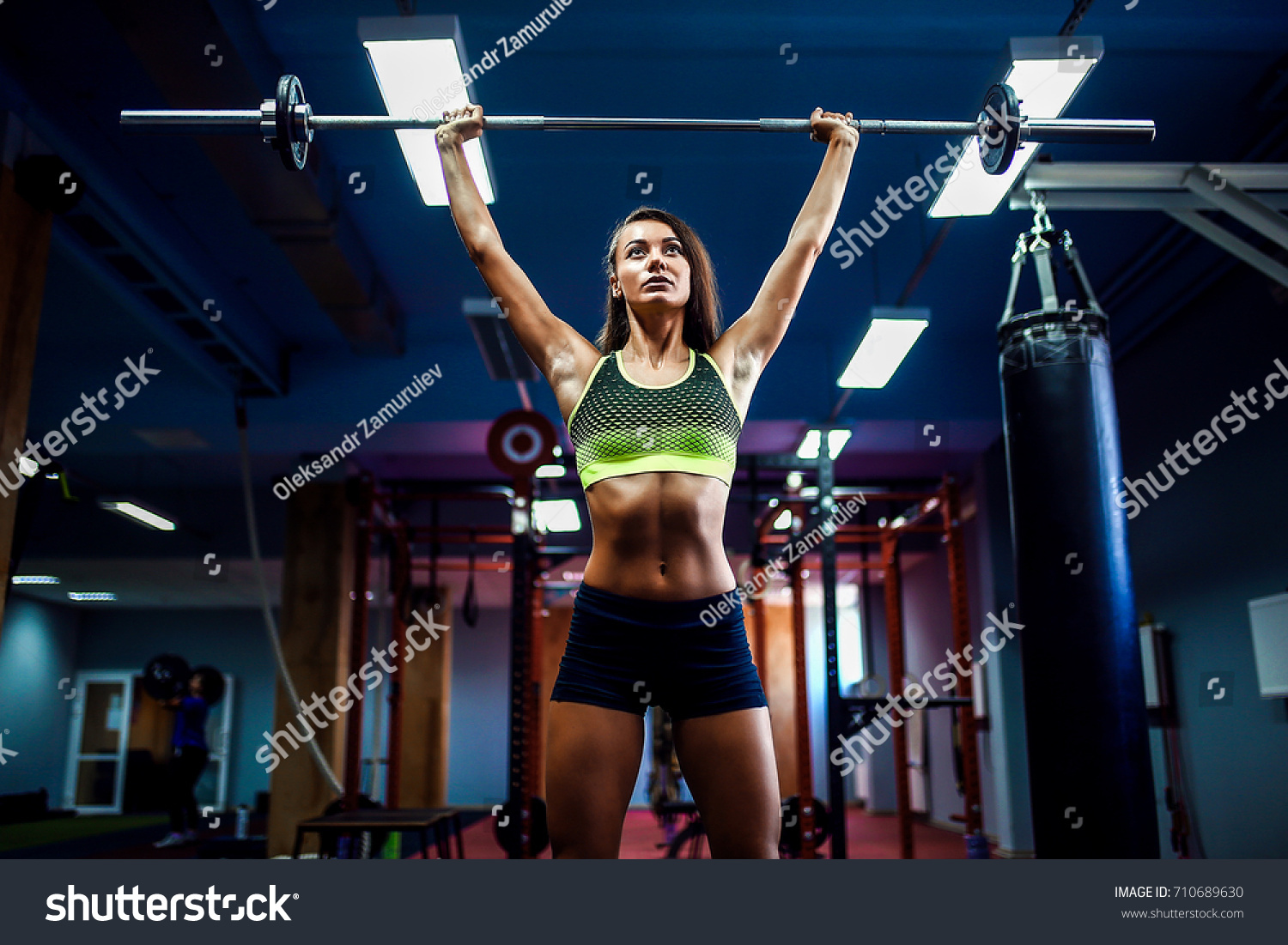 Young fitness woman lifting weight crossfit stock photo 710689630 young fitness woman lifting a weight crossfit in the gym crossfit woman crossfit style platinumwayz