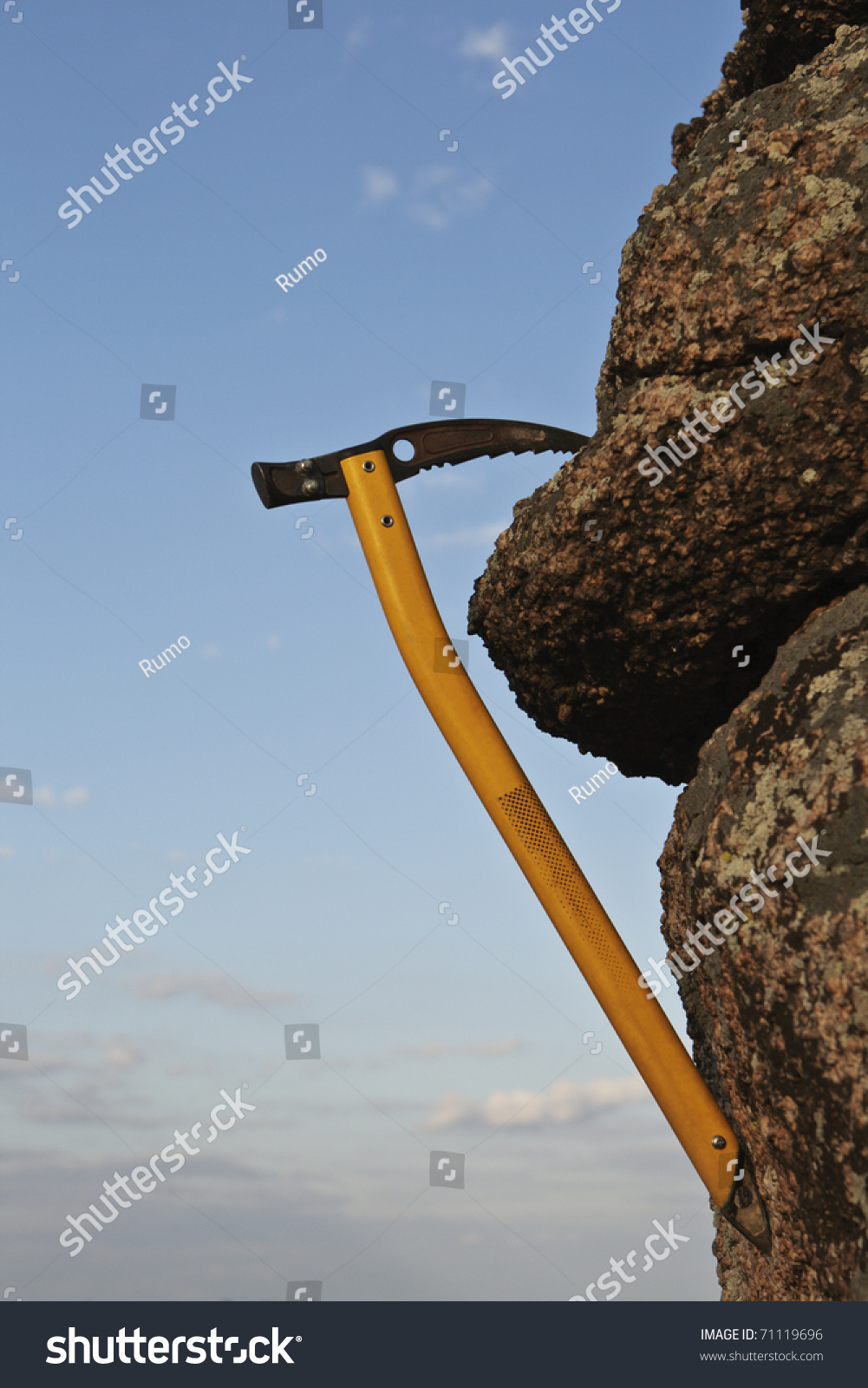 Alone Hanging Ice Axe On Rock Stock Photo 71119696