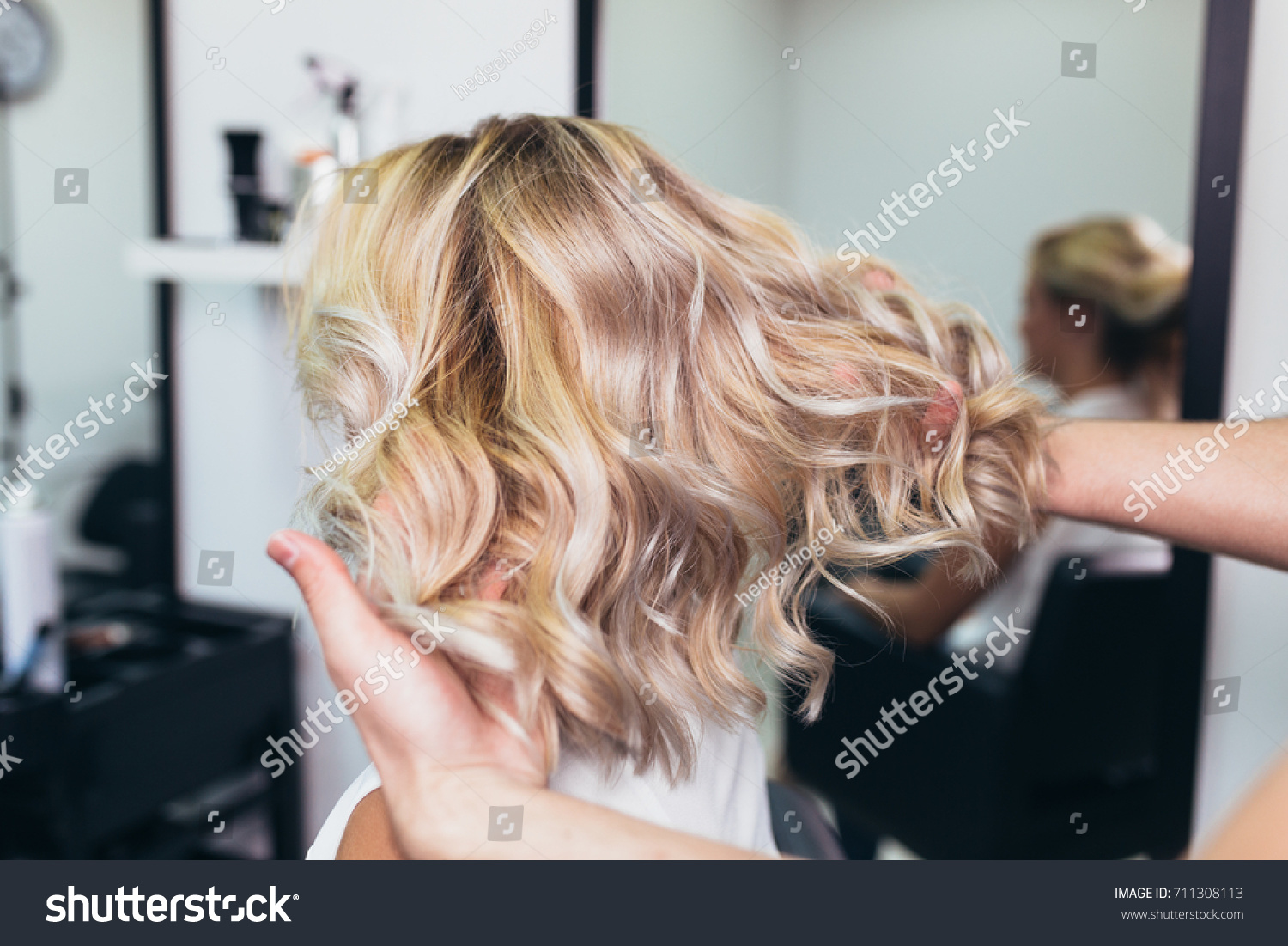 Beautiful hairstyle young woman after dying stock photo 711308113 beautiful hairstyle of young woman after dying hair and making highlights in hair salon pmusecretfo Gallery