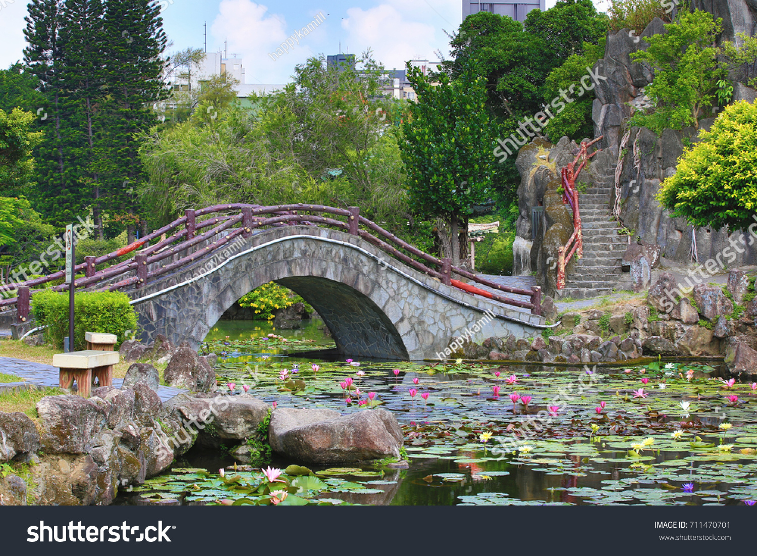Beautiful garden scenery lotus flowers leaves stock photo edit now beautiful garden scenery of lotus flowers and leaves with stone bridge and stairs in the pond izmirmasajfo
