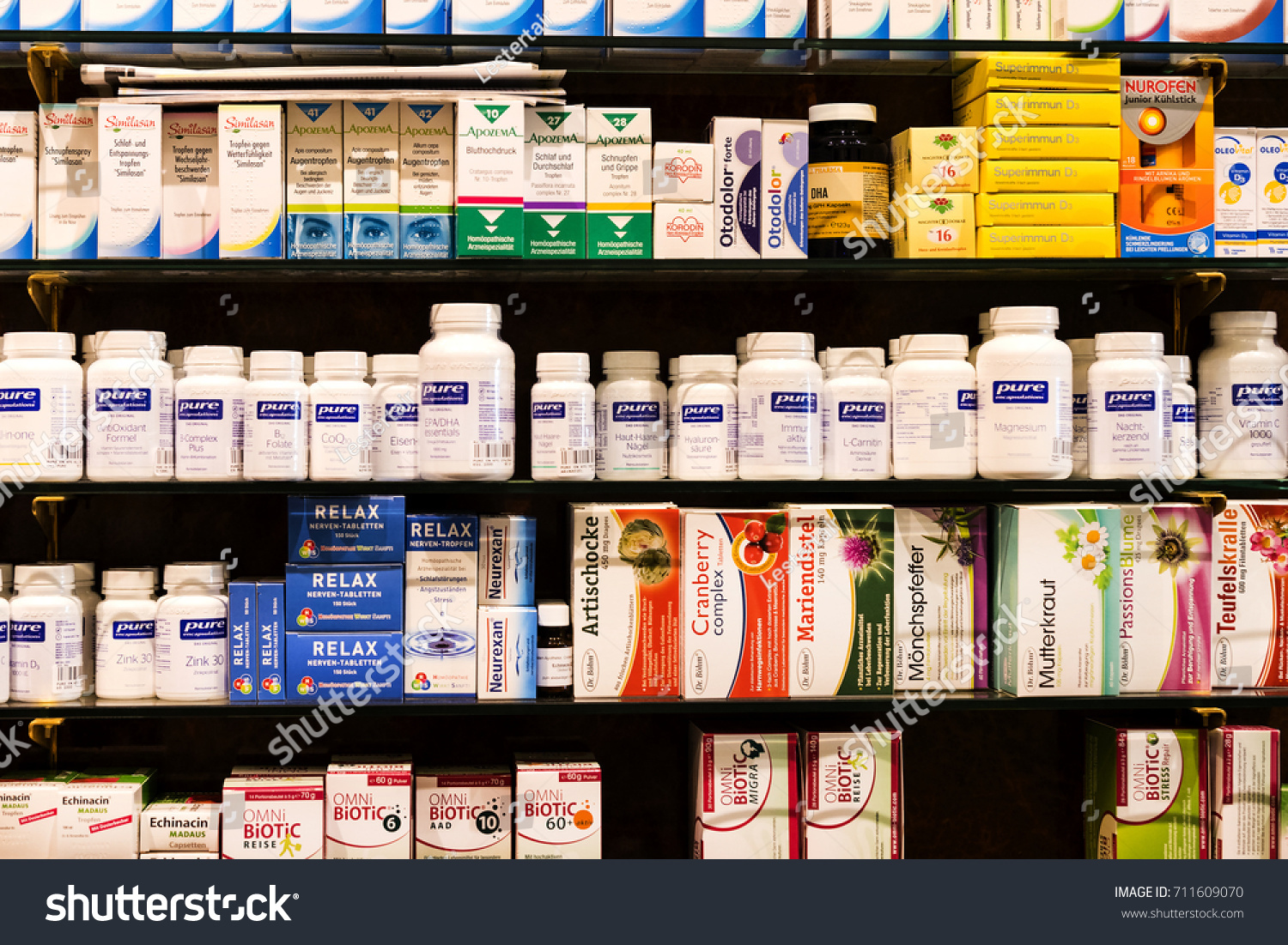 VIENNA, AUSTRIA - 23 AUGUST 2017:The interior of the city pharmacy in the shelves with medicines and preparations. #711609070