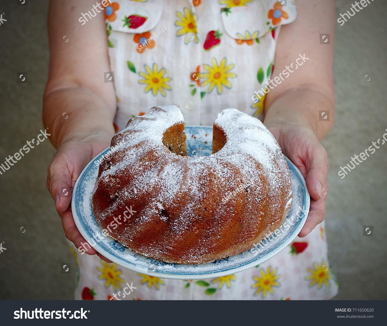 Grandma holding bundt cake hands cooking stock photo royalty free grandma holding a bundt cake with hands cooking cake recipe card vintage food forumfinder Gallery
