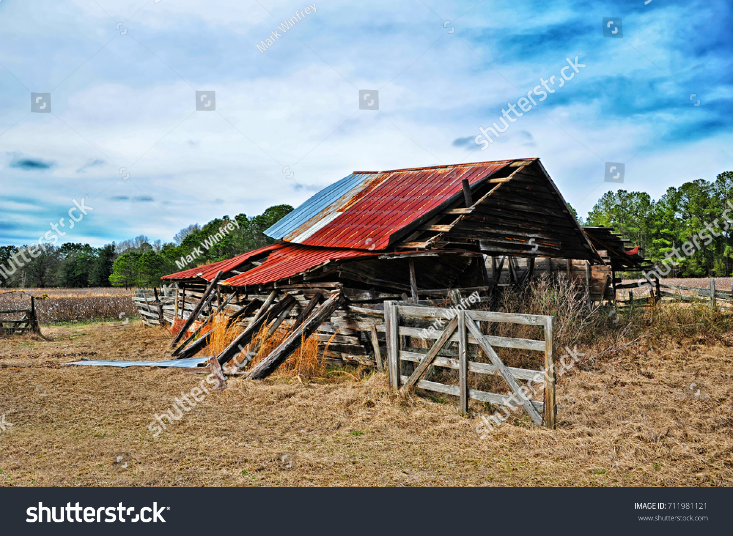 stock-photo-an-abandoned-rustic-barn-in-