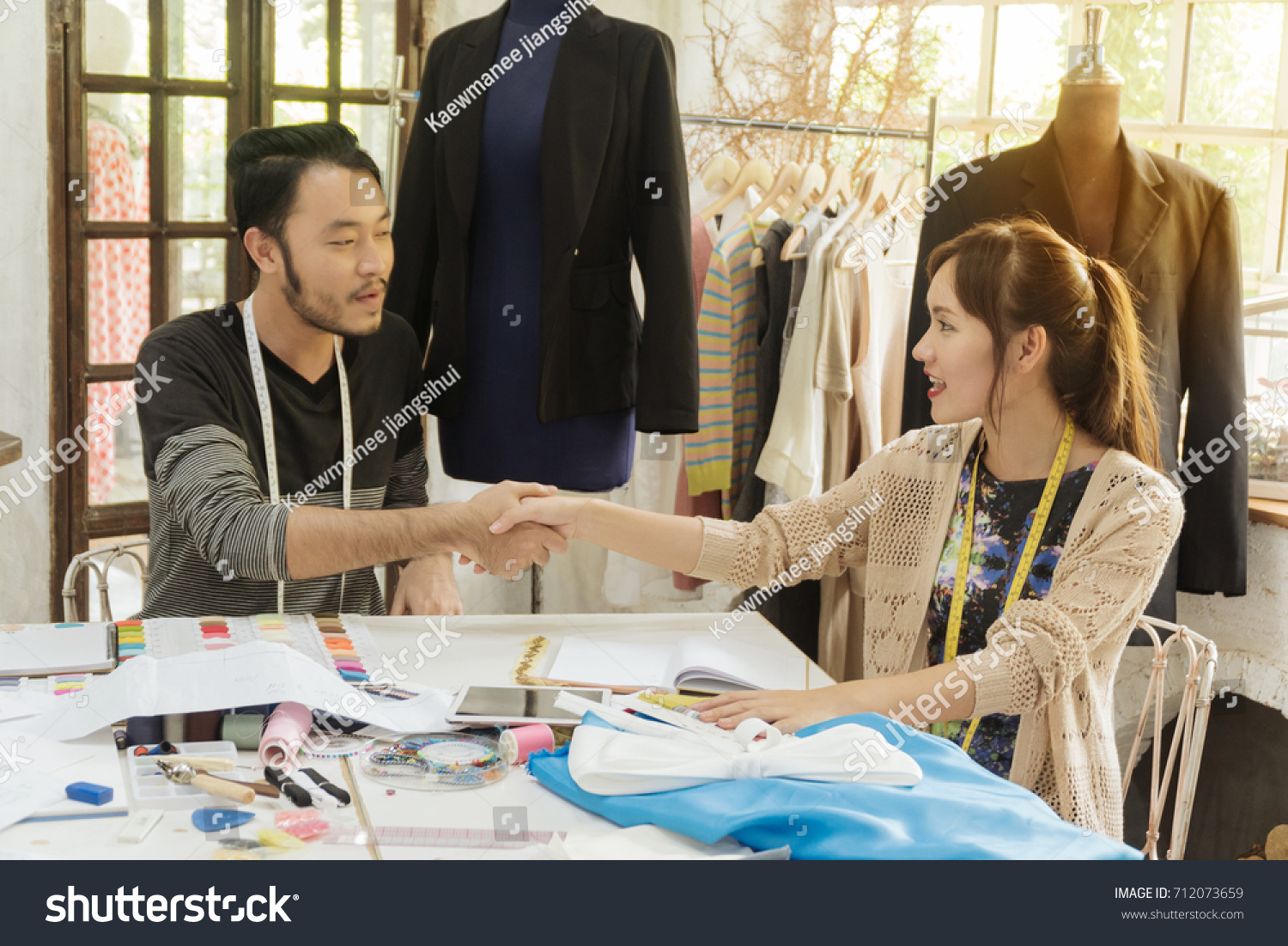 Two Asian Young Fashion Designer Handshake Stock Photo Edit Now On The Table At Studio Cooperation Between