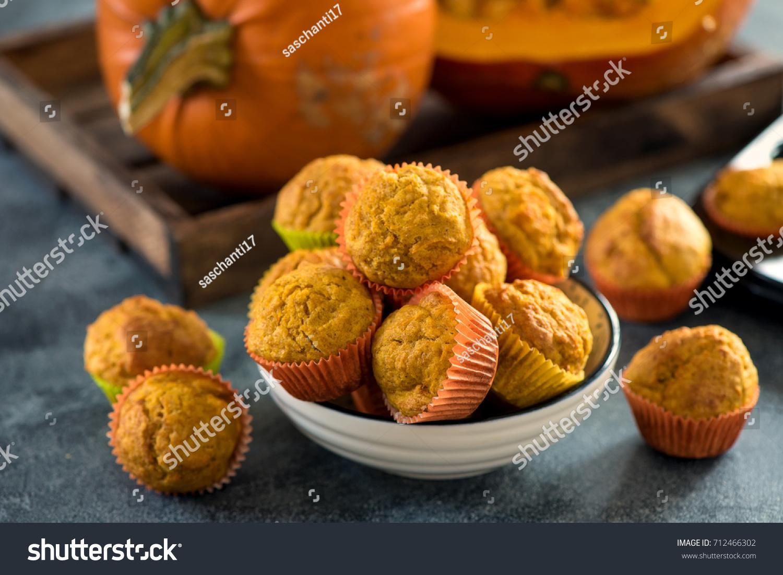 Healthy pumpkin muffins, vegan baked food, autumn dessert #712466302