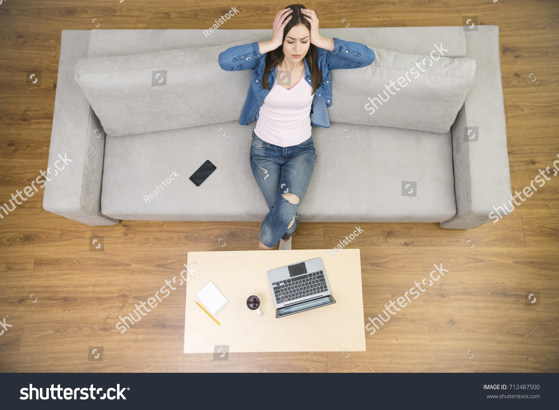 Woman Headache Sit On Sofa View Stock Photo Edit Now 712487500