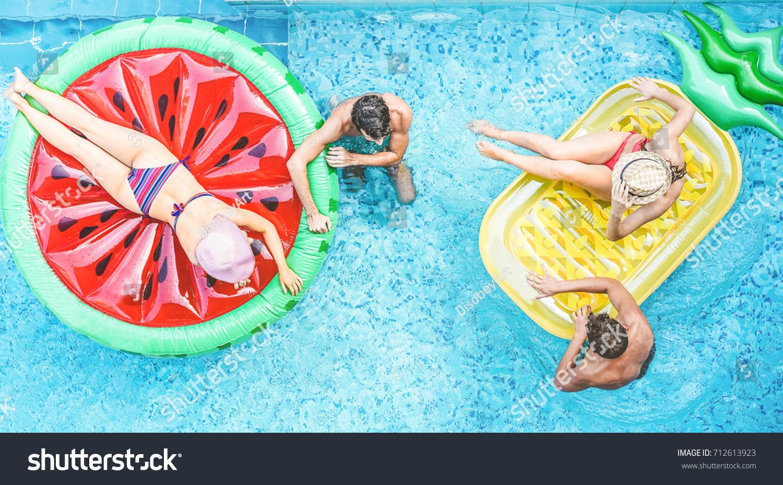 Happy Friends Having Fun Inside Swimming Stock Photo 712613923