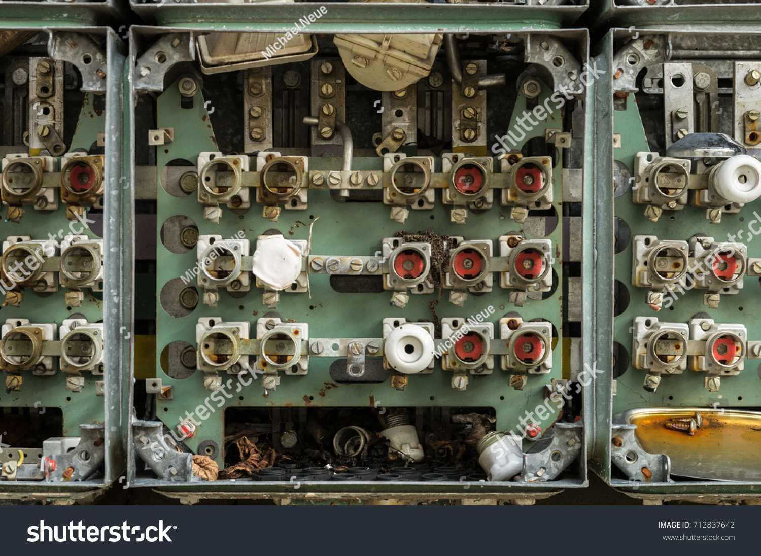 An old fuse box with cables and connectors