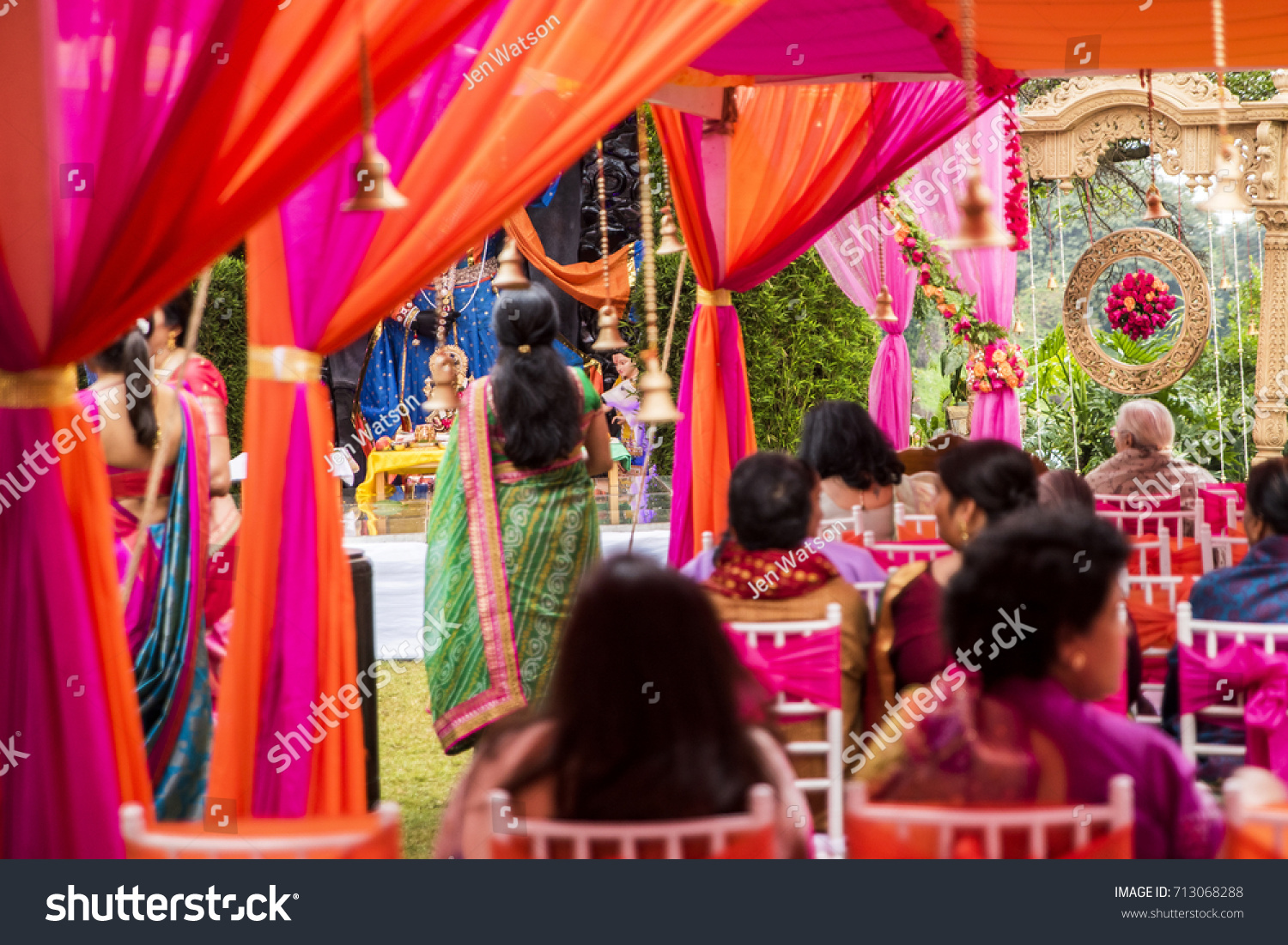 Traditional Hindu Wedding Arch And Rose Ball Viewed Through Vibrant Outdoor Setting For Indian Pre