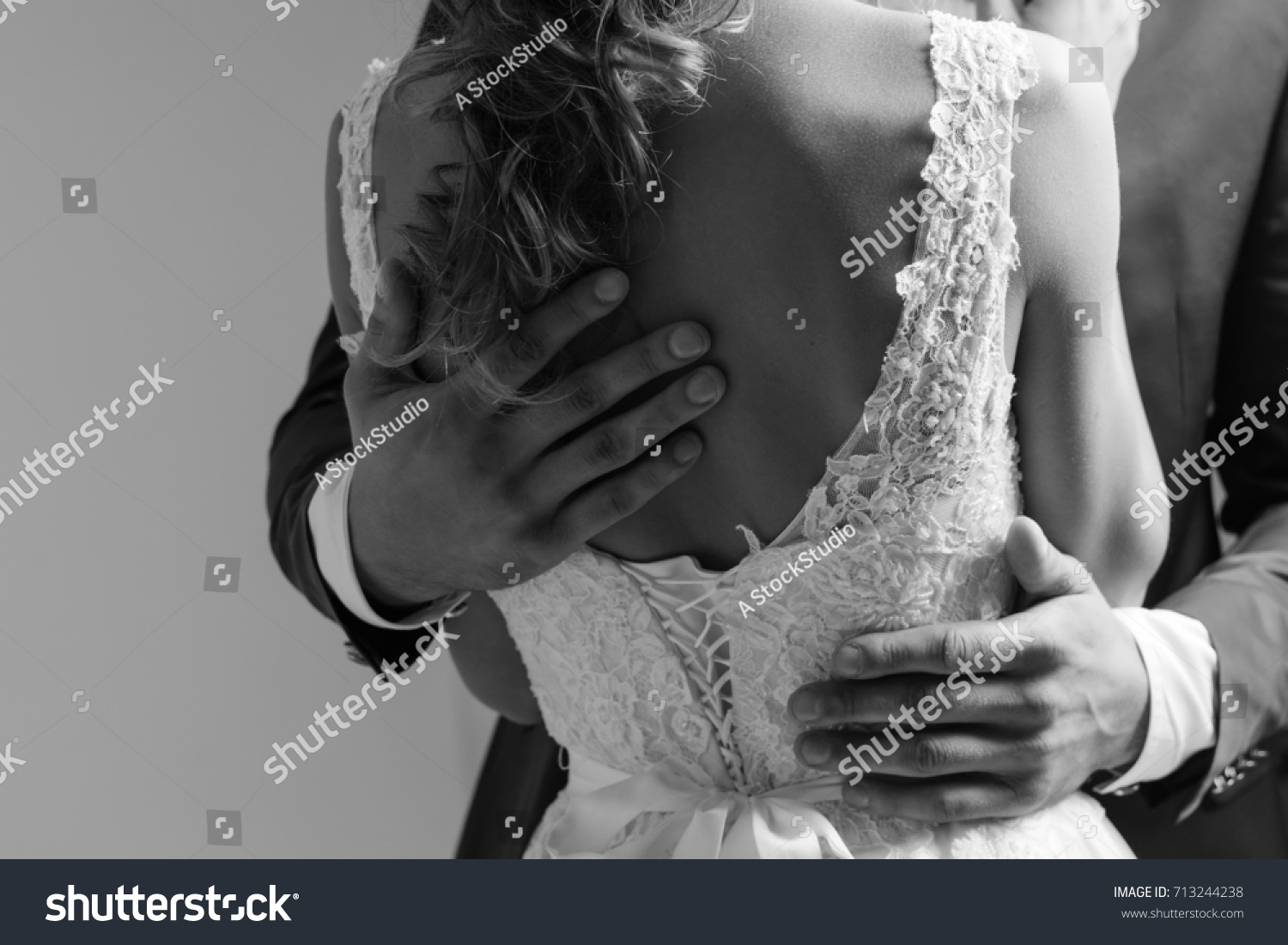 People no face black and white photo of a closeup loving couple on a wedding