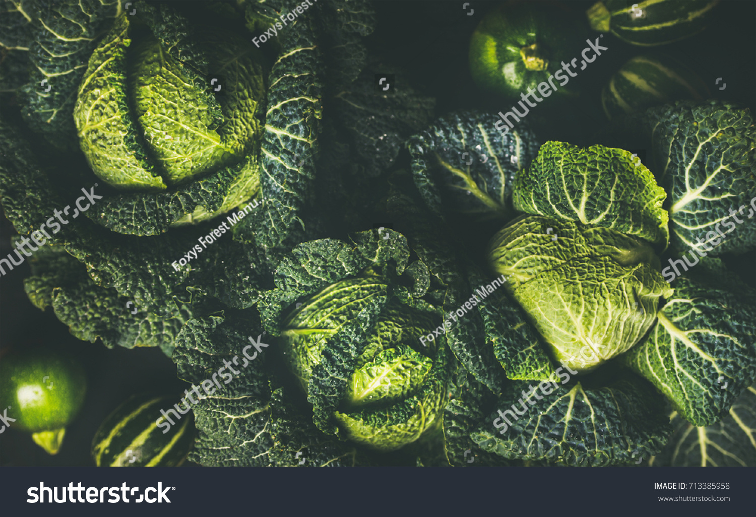 Raw fresh green cabbage texture and background, top view over dark background, selective focus #713385958