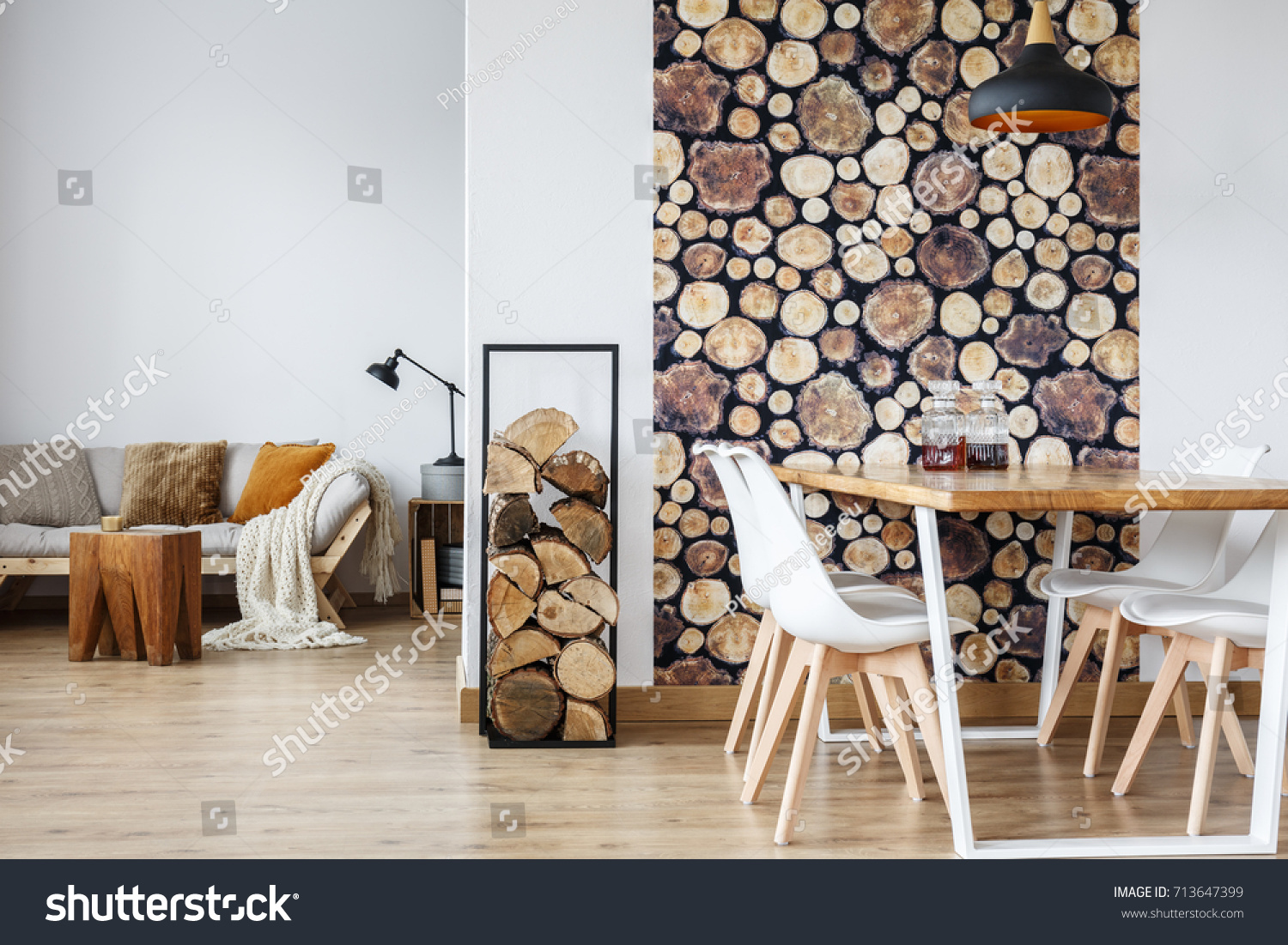 Open Dining Room Interior With Firewood, Communal Table And Wooden Log Wall  Decoration For Warm