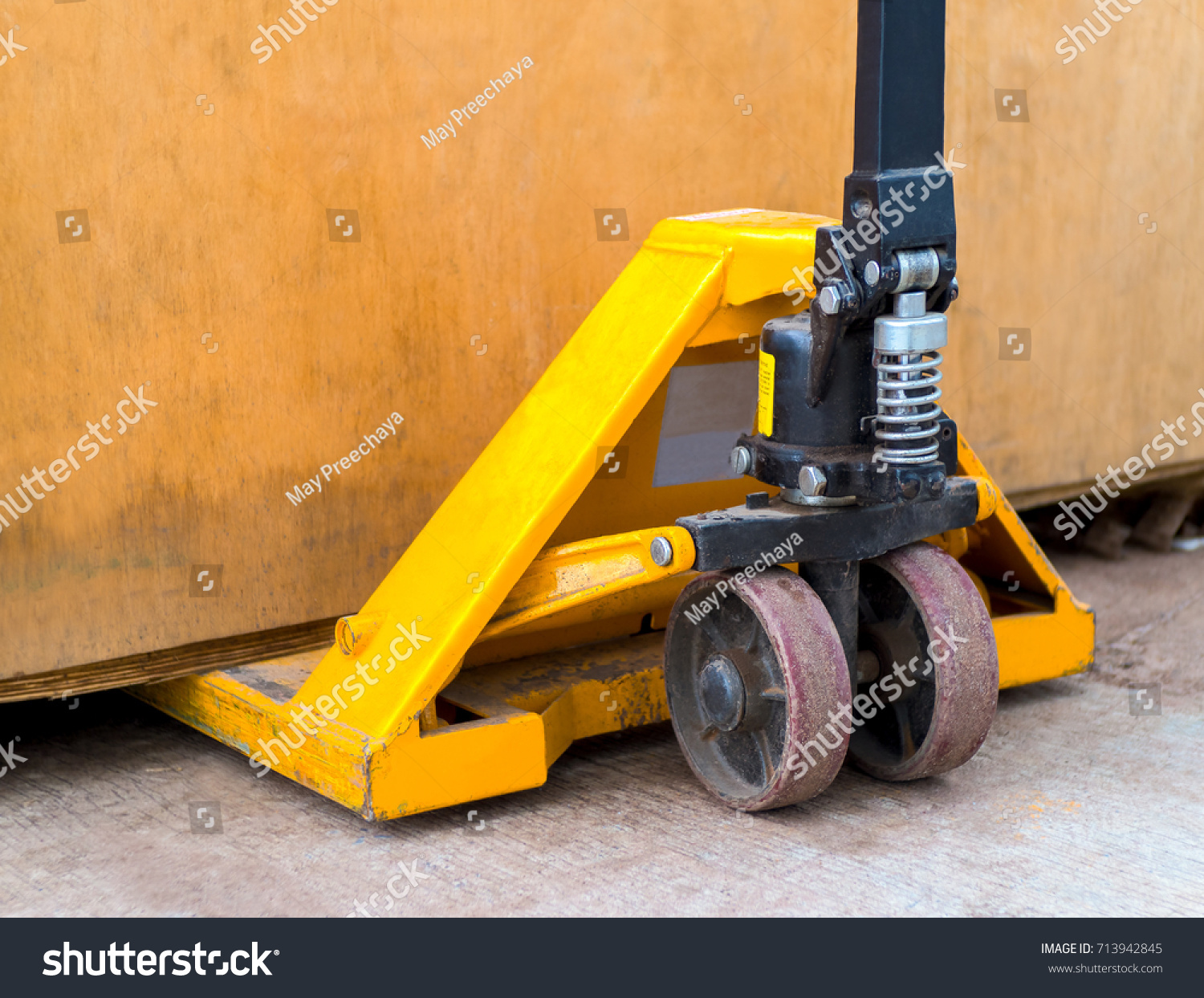 Old Yellow Manual Hand Pallet Trucks Stock Photo Edit Now Snow Plow Wiring Diagram Box Close Up Wheel Of Hydraulic Truck Or