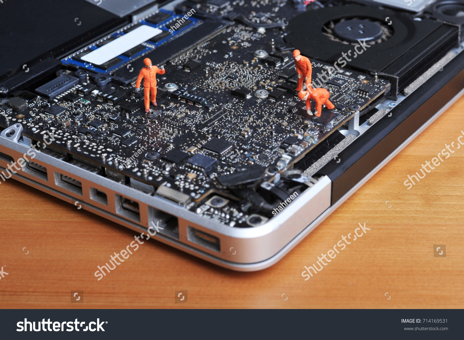 Figurine Technician Doing Maintenance At Part Of Circuit Inside A Recycled Board Small Notebook Broken Laptop On Top Wooden Table And Technology Conceptual Ez Canvas