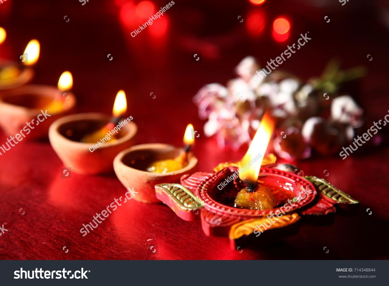 Diwali Greetings Diya Lighting Stock Photo Royalty Free 714348844