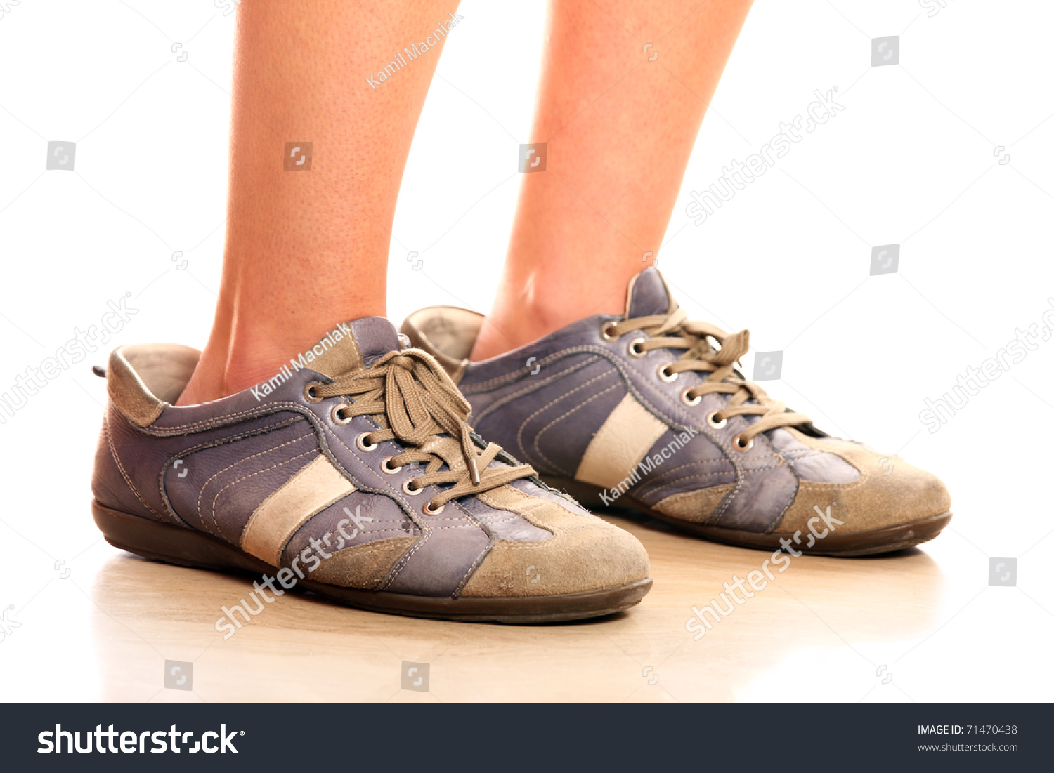 Background image too big - A Closeup Of Female Legs Trying On Too Big Male Shoes Over White Background