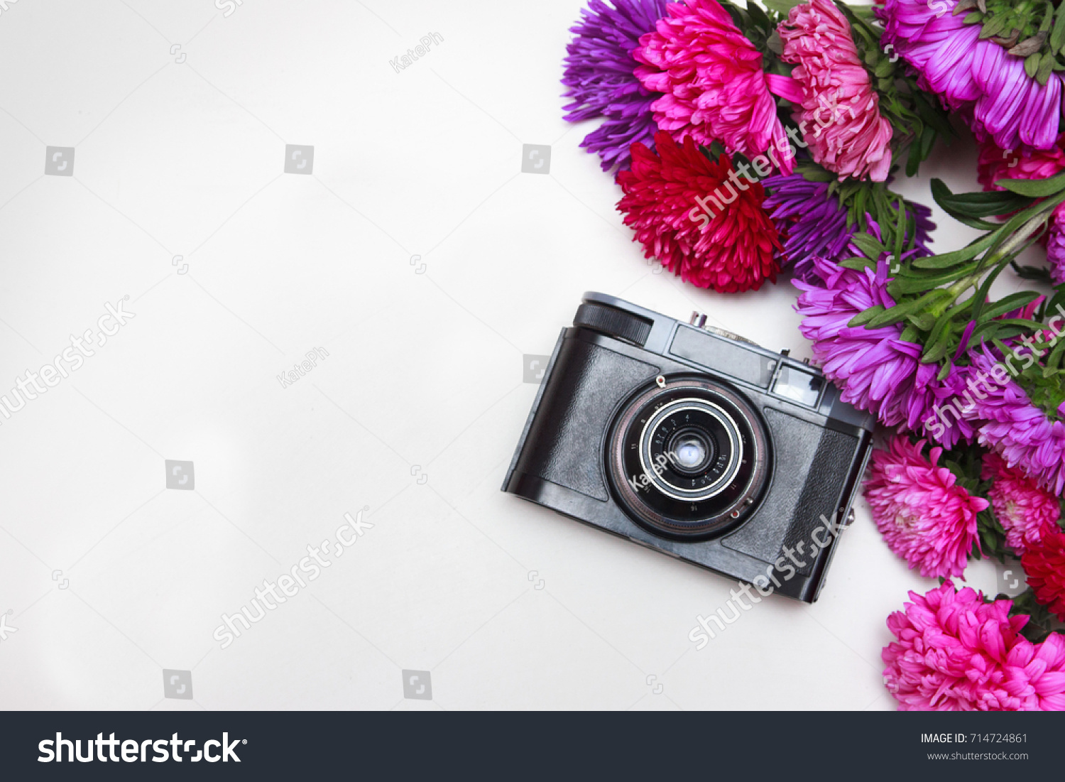 Flat Lay Floral Frame With Vintage Retro Camera Red And Pink Flowers Buds Pattern On