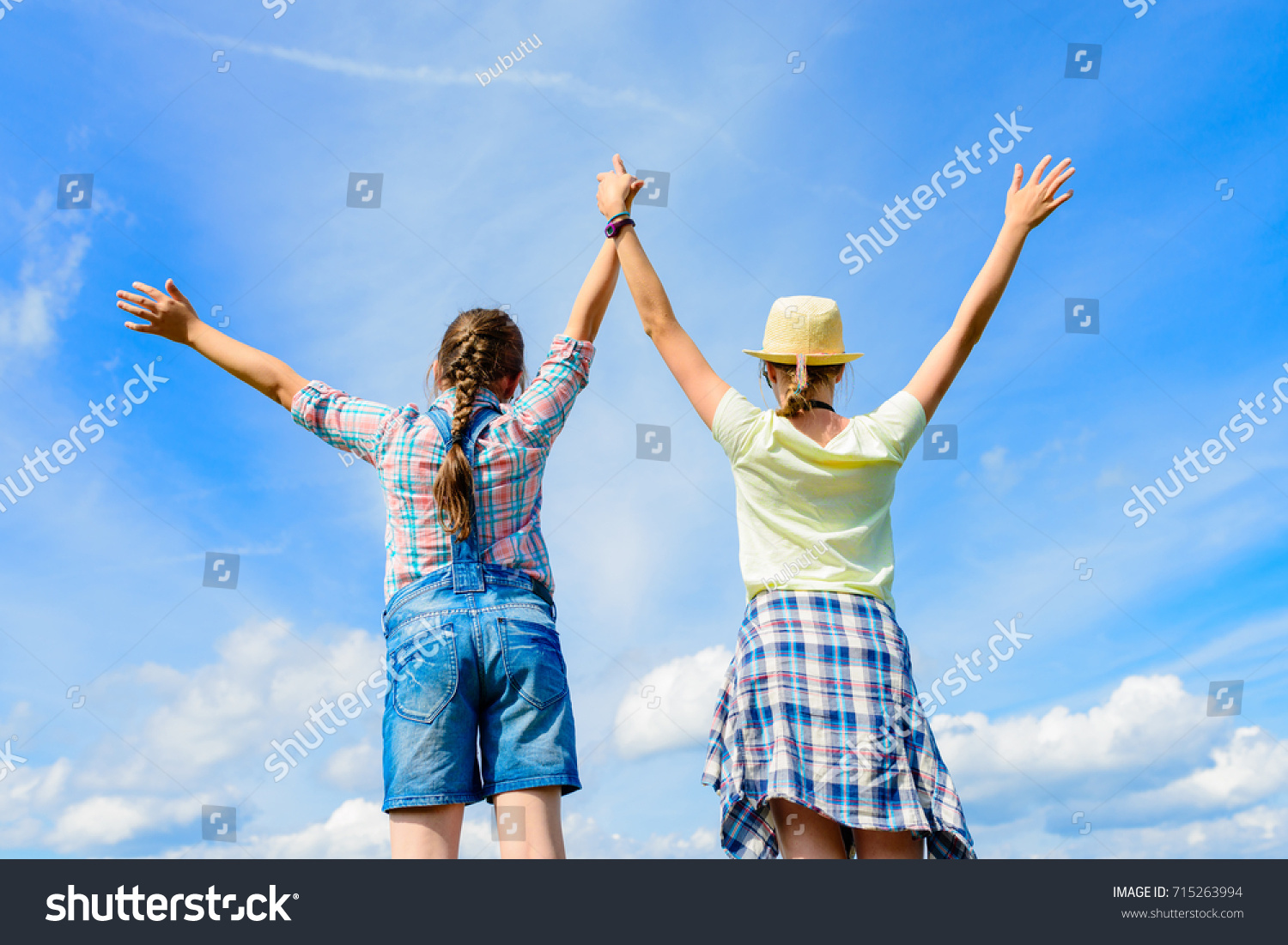 Happy Friends With Open Arms Under Blue Sky Two Girls Having Fun