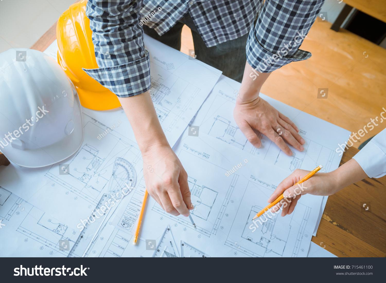 Group architect working on blueprint engineer stock photo group of architect working on blueprint engineer inspective in workplace architectural project blueprints malvernweather Gallery