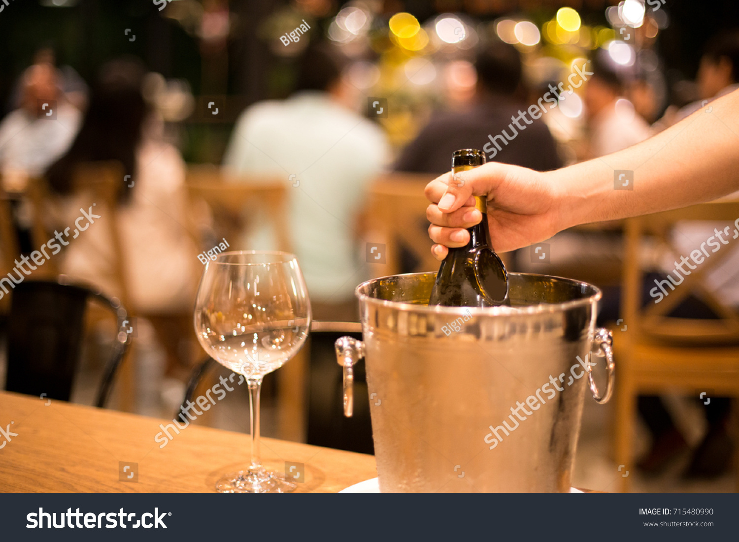 Shot in high iso with low light man hand grabbing bottle of wine in ice bucket & Shot High Iso Low Light Man Stock Photo 715480990 - Shutterstock azcodes.com
